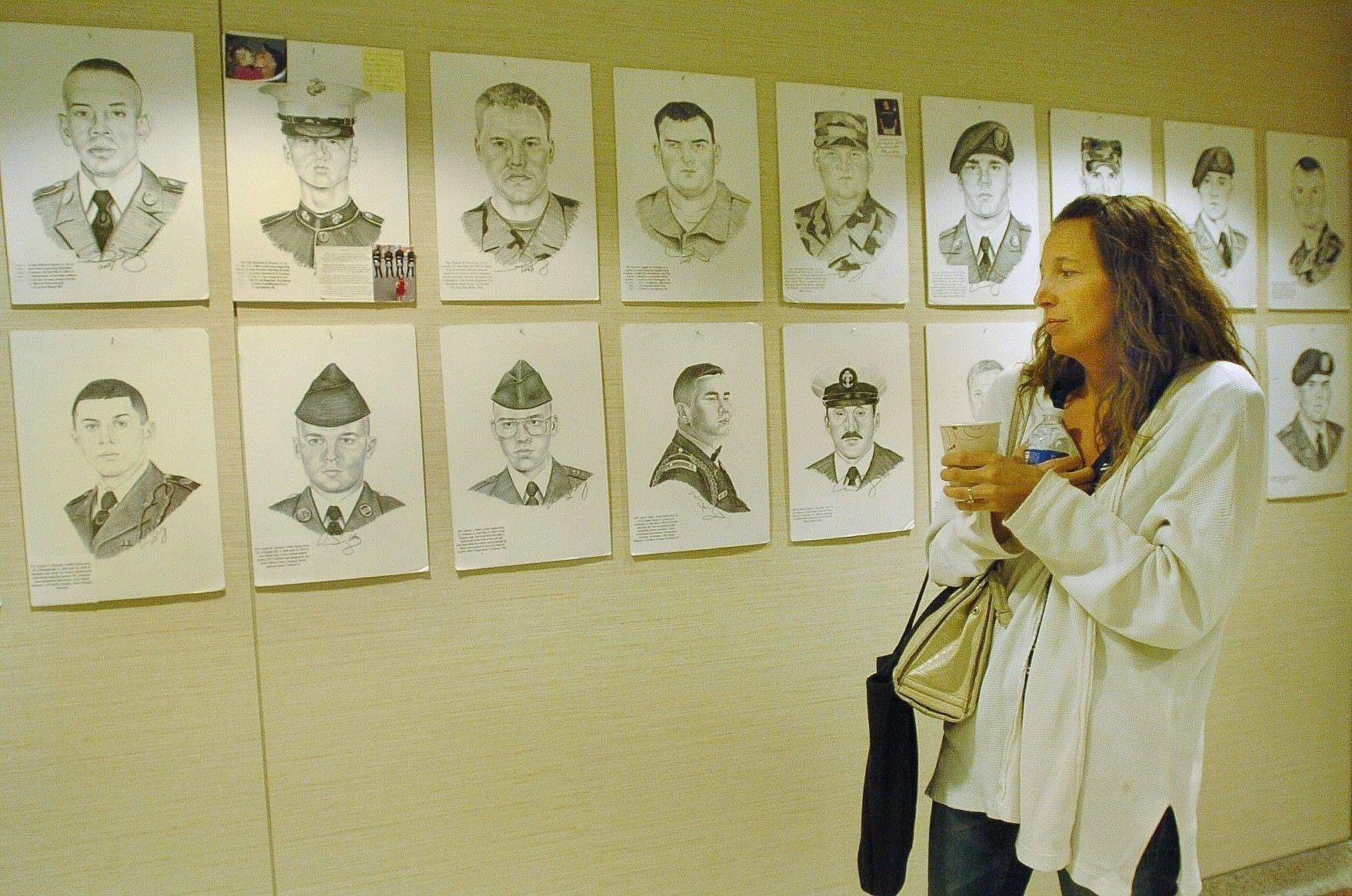 "Sally Kolb of Rolling Meadows views ""Portrait of a Soldier"" at Alexian Brothers Medical Center in Elk Grove Village."