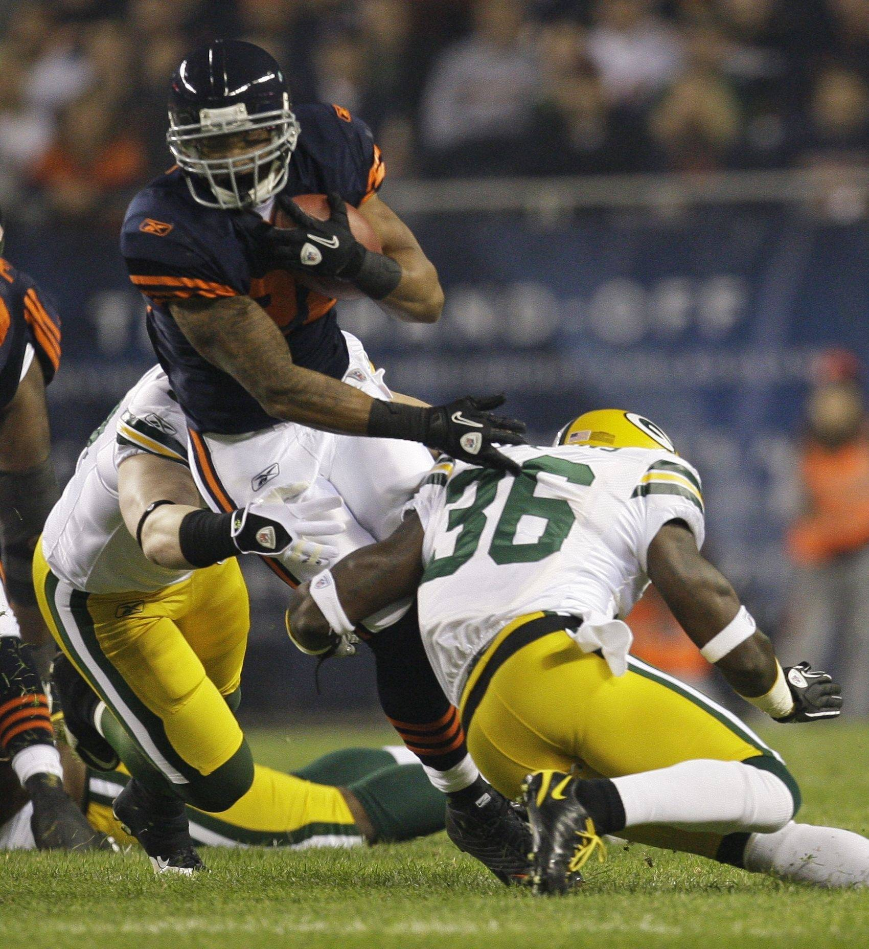 Chicago Bears running back Matt Forte is tackled by Green Bay Packers safety Nick Collins (36) and linebacker A.J. Hawk during the first half of an NFL football game Monday, Sept. 27, 2010, in Chicago.