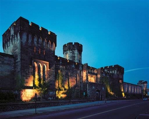 Eastern State Penitentiary shows the outside of the former state prison after dark in Philadelphia. More than 100,000 people visit the former state prison, which closed in the 1970s, each Fall to experience its reincarnation as a haunted house.