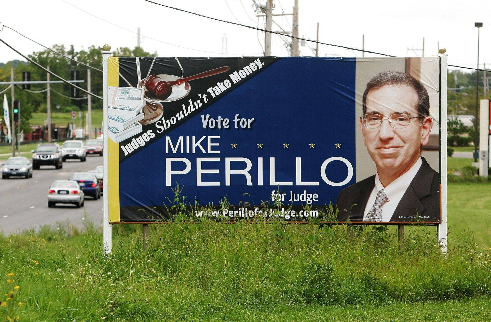 "Candidate Mike Perillo's billboard on Route 83 in Round Lake Beach declares, ""Judges shouldn't take money."""