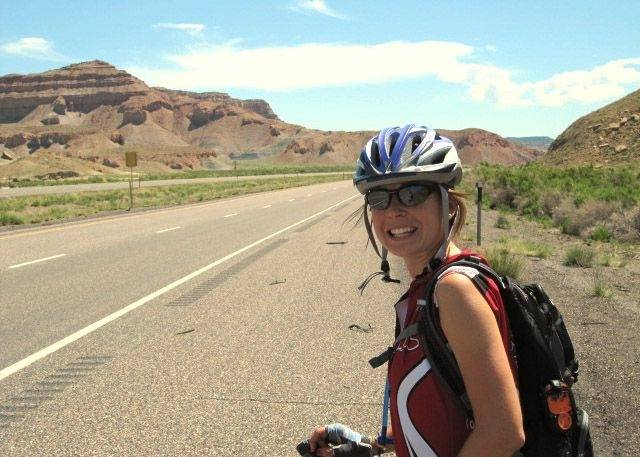 Kirsten Pufahl of Batavia rode her bike cross-country to raise money for an AIDS charity.