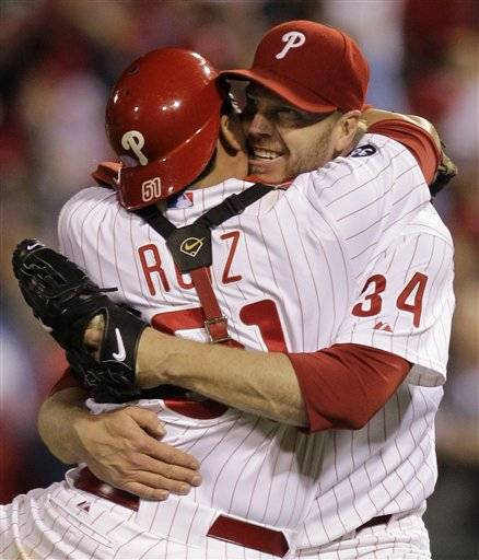 Philadelphia Phillies starting pitcher Roy Halladay  celebrates with catcher Carlos Ruiz (51) after throwing a no-hitter to defeat the Cincinnati Reds 4-0 during Game 1 of baseball's National League Division Series Wednesday,