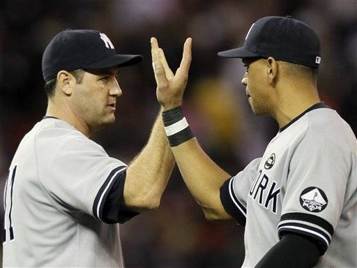 New York Yankees' Lance Berkman, left, and Alex Rodriguez celebrate after Game 2 of baseball's American League Division Series against the Minnesota Twins, Thursday in Minneapolis.