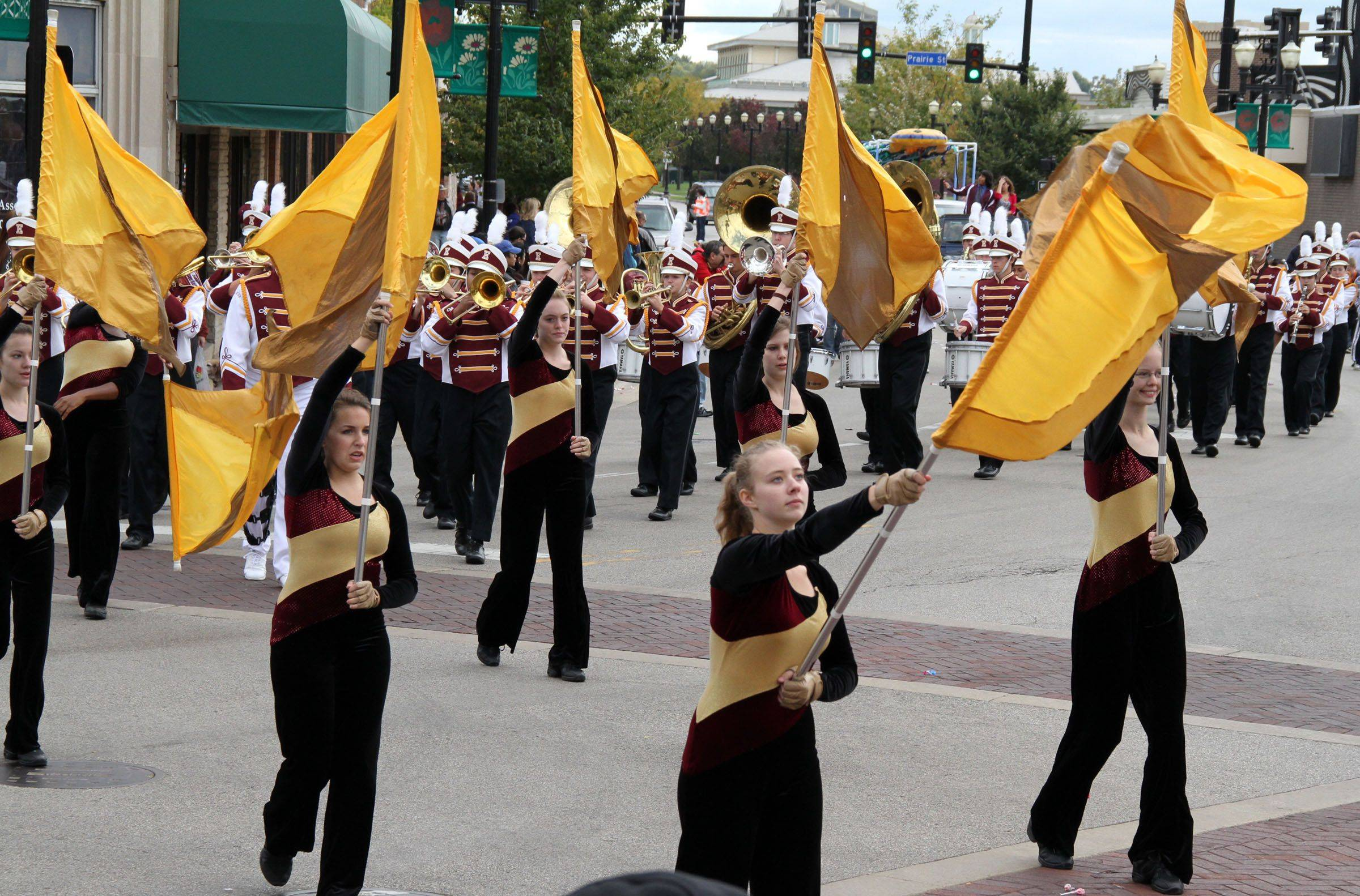 The Elgin High School flags squard marches in the homecoming parade through downtown Elgin on Sunday, October 3.