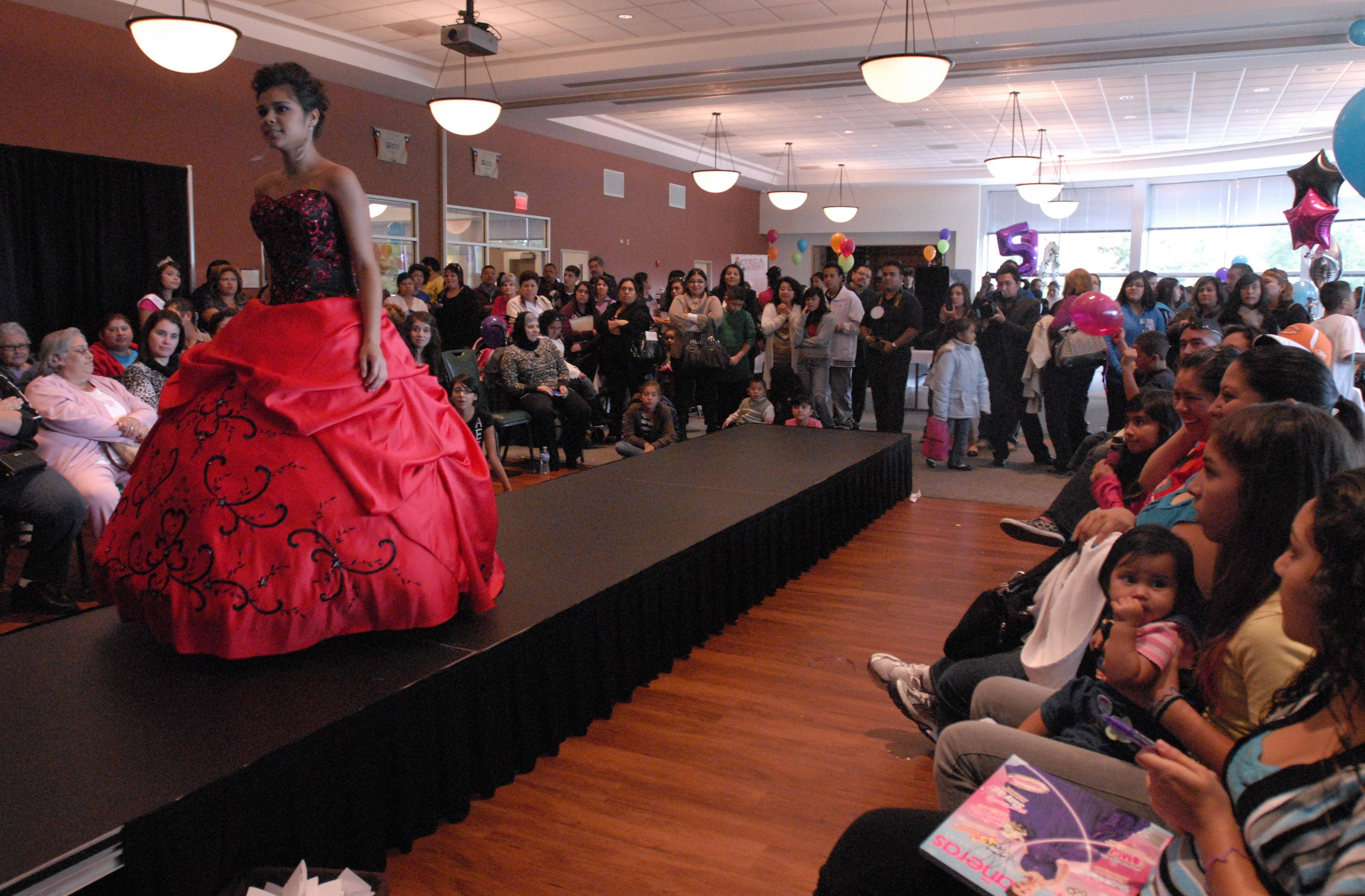 Martza Juarez, 15, is the last to walk the runway at the Centre of Elgin during a showcase of venders for Quinceaneras Sunday afternoon.