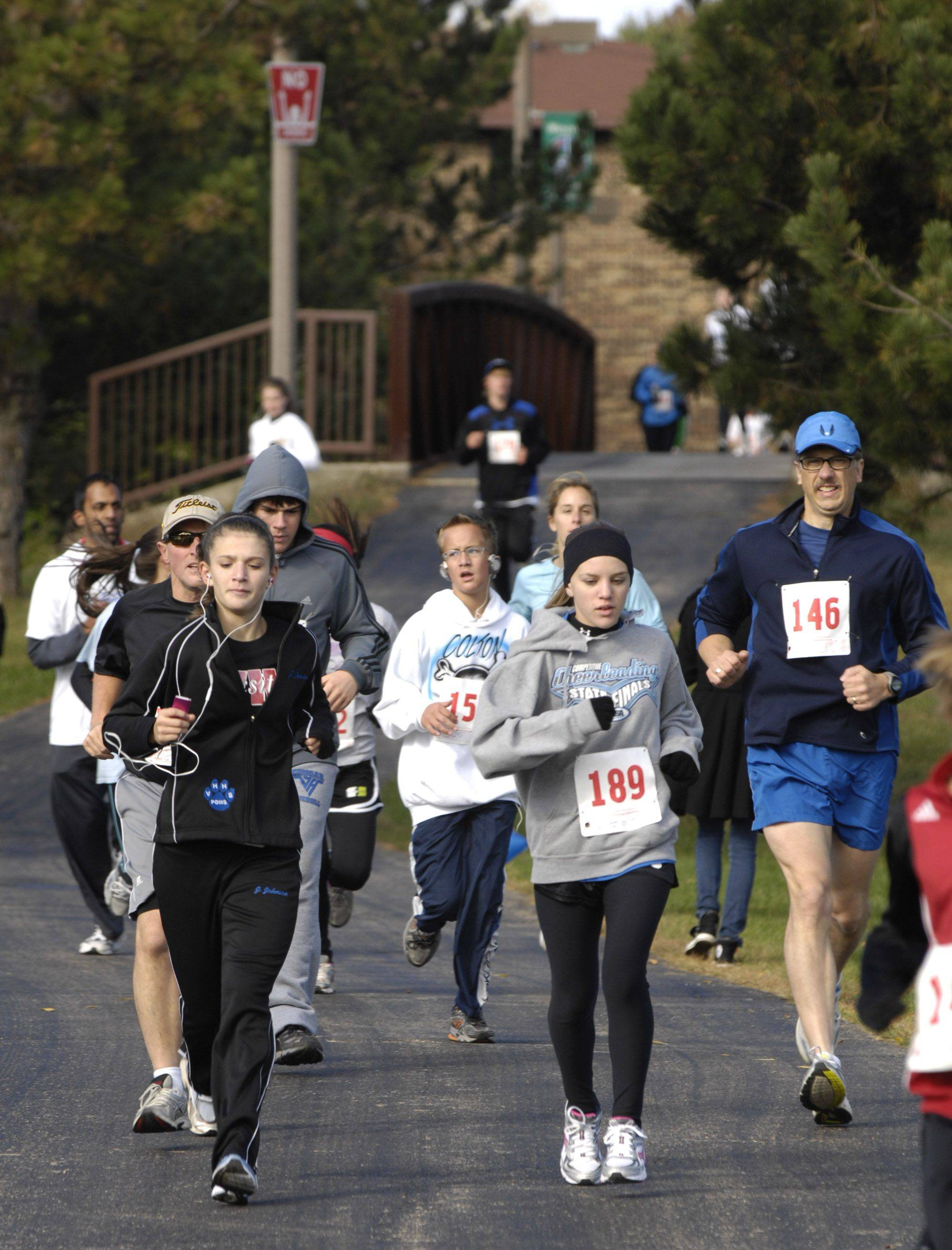 Runners take part in the 5K race around Big Bear Lake in Vernon Hills to benefit the Glaucoma Research Foundation. The event was sponsored by Vernon Hills High School's Health and Wellness Committee.