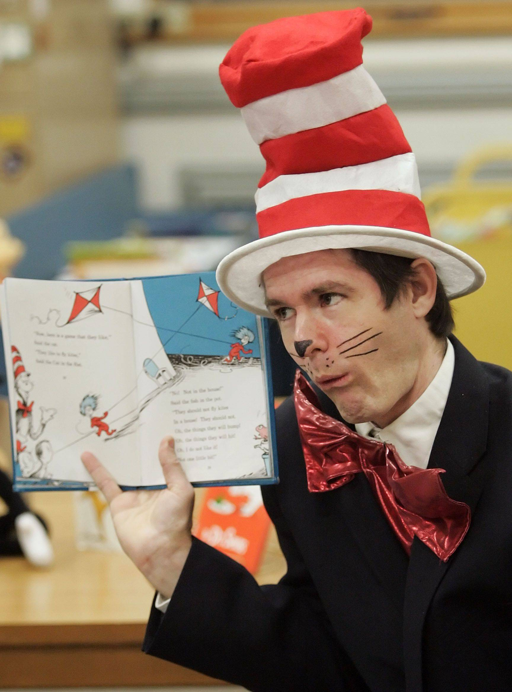 "Story Teller Dean Griffiths of Lake Villa reads ""The Cat in the Hat to second and third graders in Mundelein Monday night."