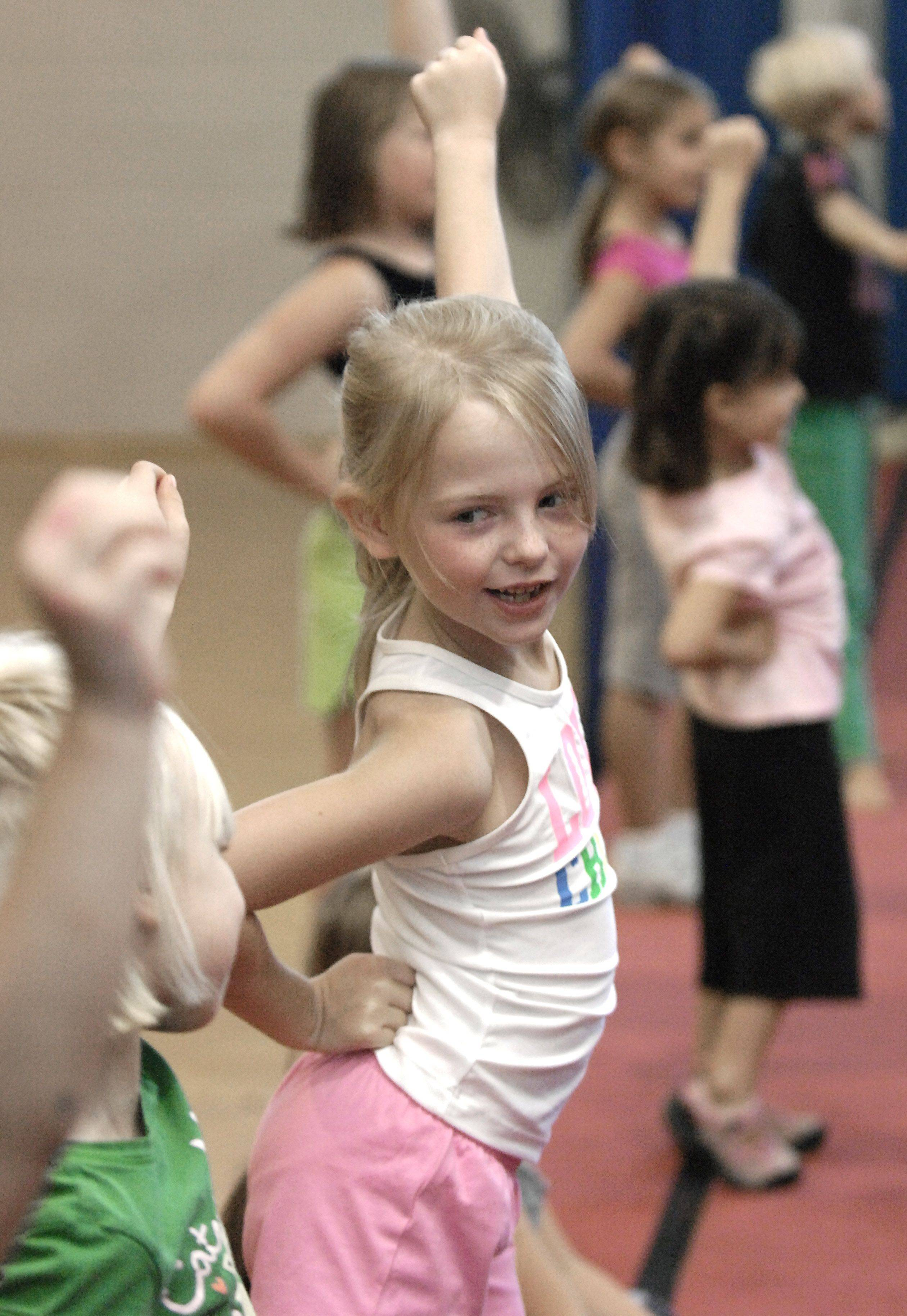 Sasha Nahorski, 7, of Batavia, plays along with a game called Cheerleader Says during Batavia Park District's cheer class for young girls.