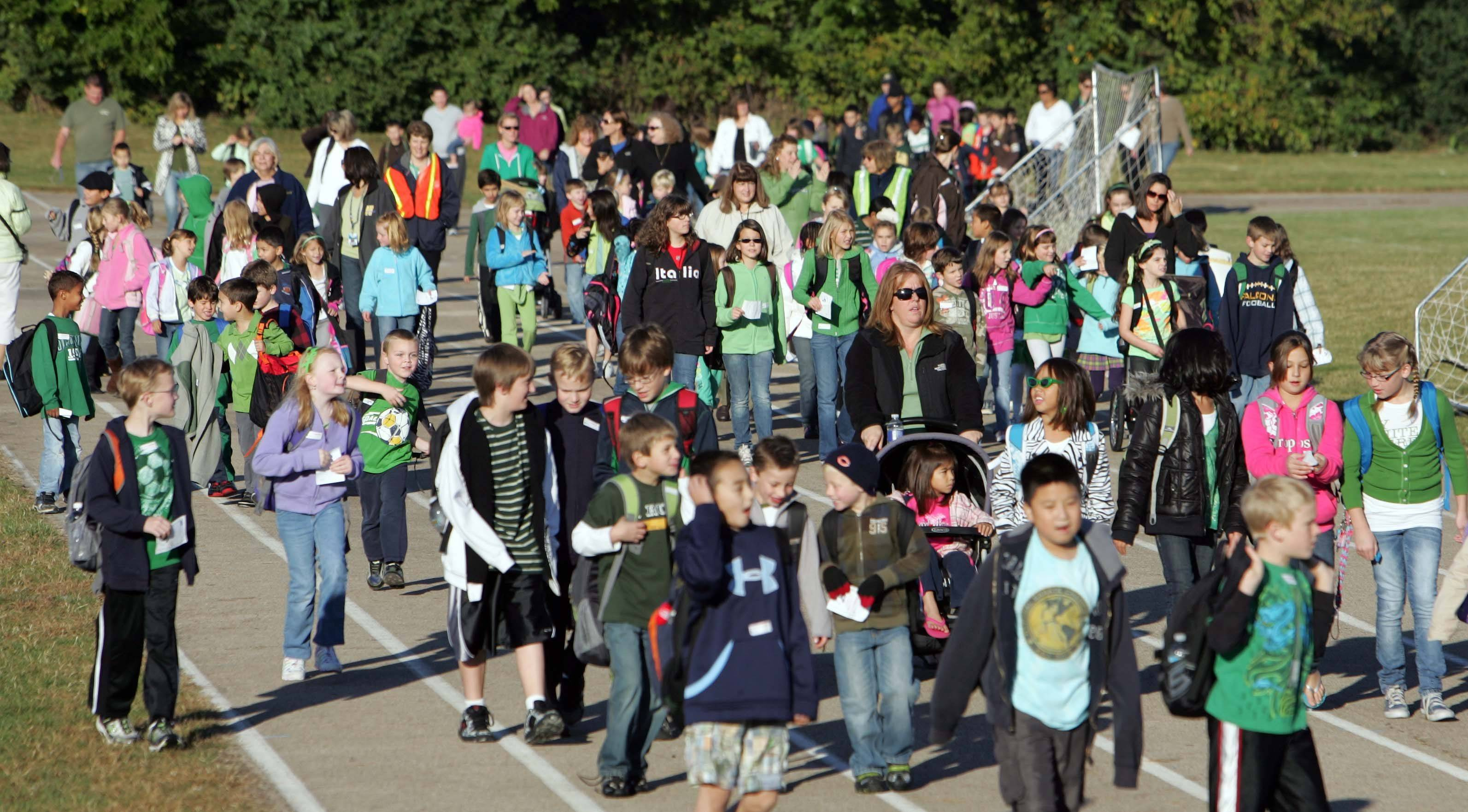 More than 400 students at Westfield Community School in Algonquin participated in the International Walk to School day. Students who had to ride busses to school got a chance to walk around the track instead.