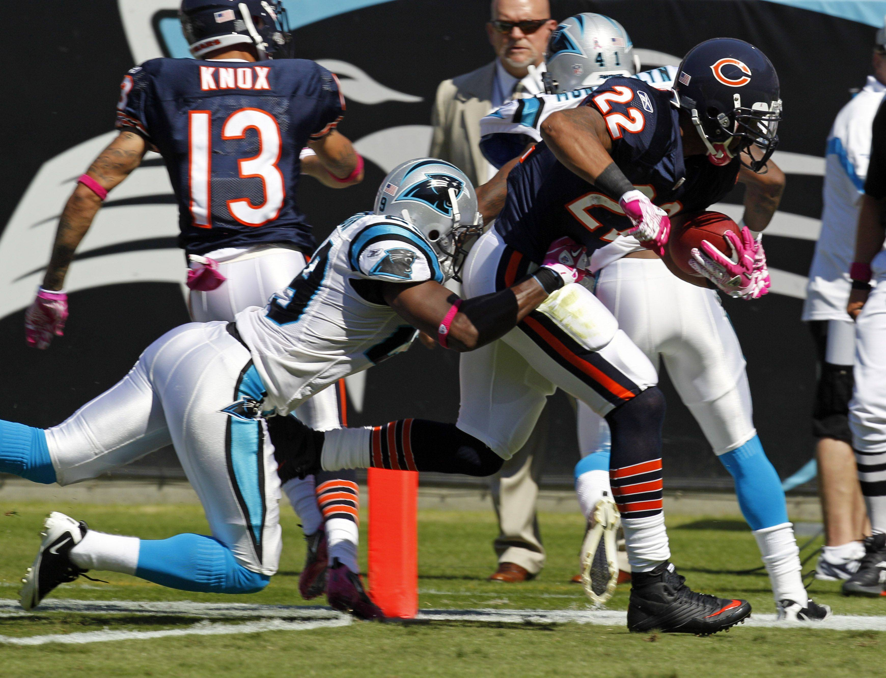 Matt Forte crosses the goal line for a touchdown as Carolina Panthers' Jordan Pugh hangs on.