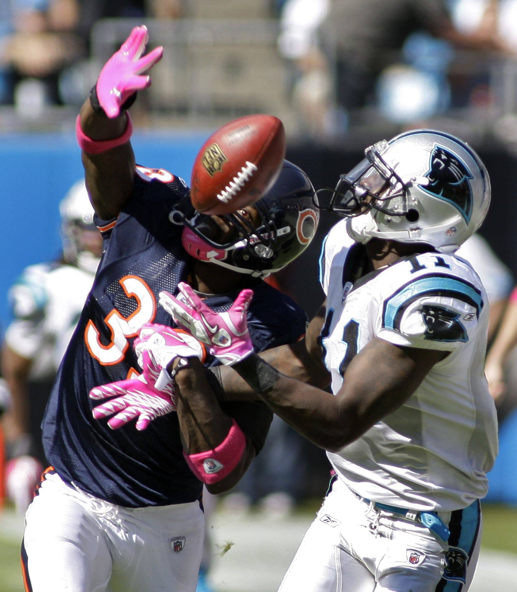 Carolina Panthers' Brandon LaFell battles Chicago Bears' Charles Tillman for a catch in the first half.