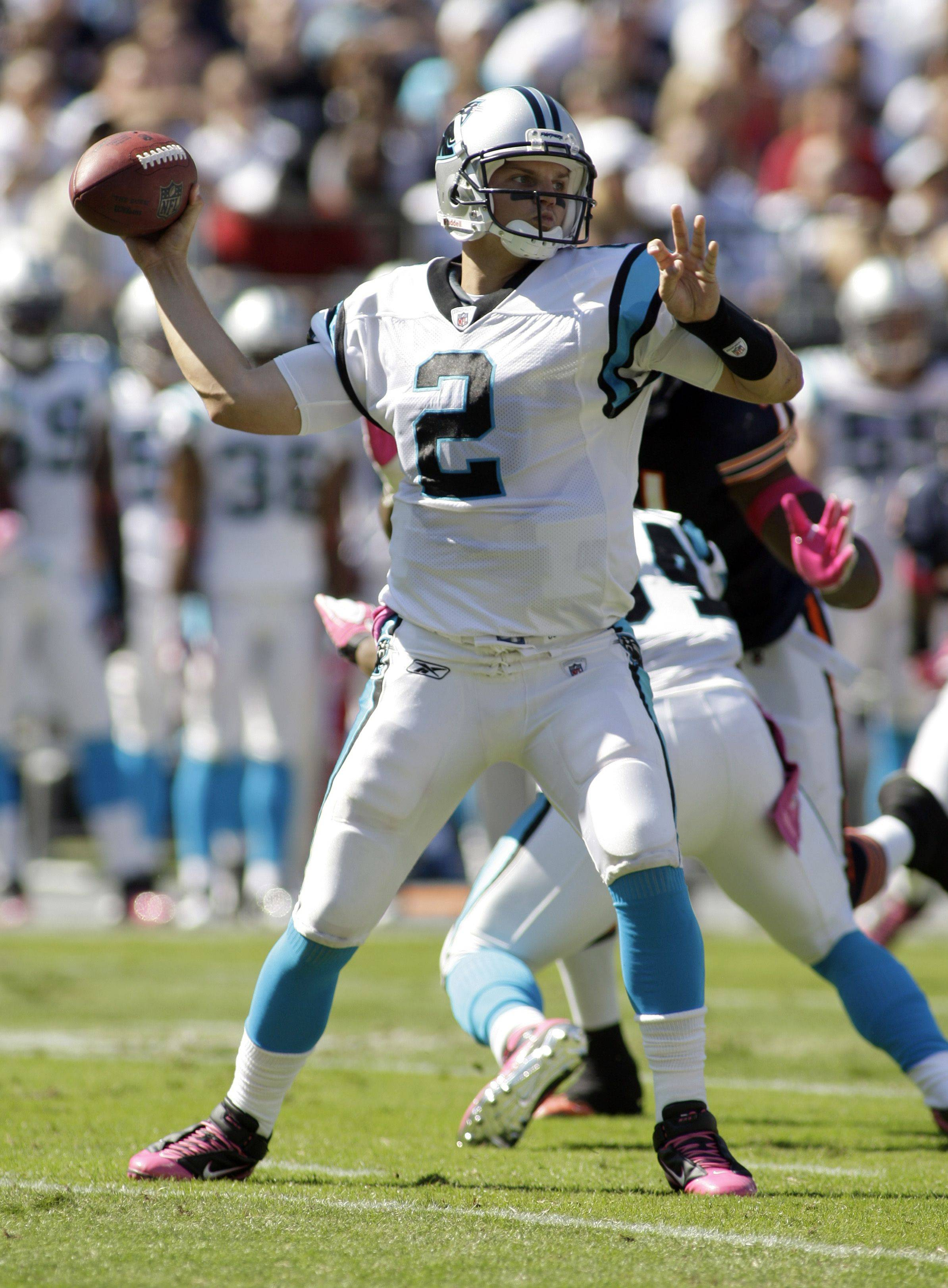 Carolina Panthers quarterback Jimmy Clausen prepares to throw a pass.