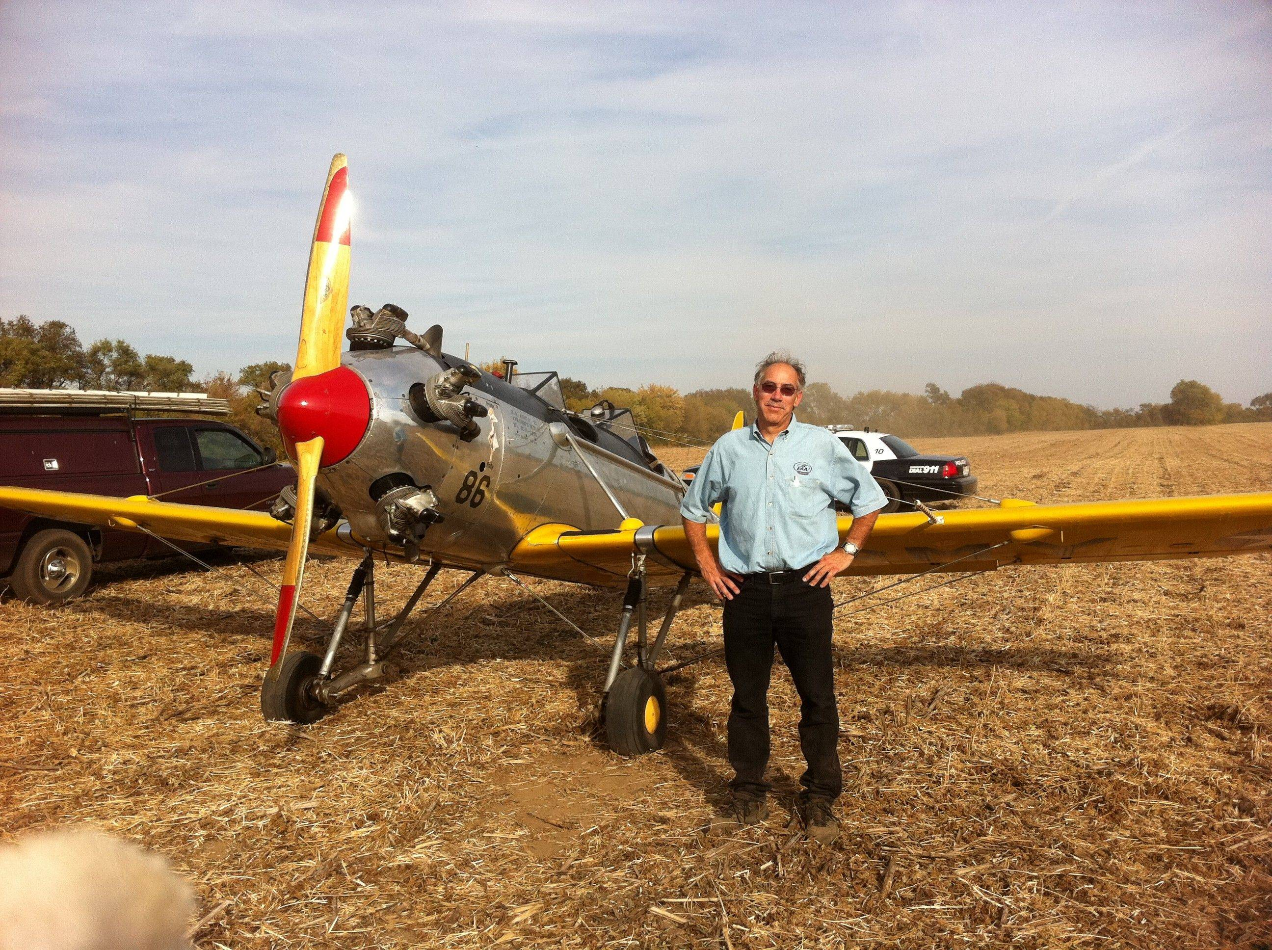Marc Kresmery of Elgin stands with his plane shortly after making an emergency landing in a soybean field Sunday. Nobody was hurt.