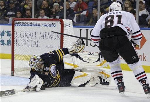 Buffalo Sabres' Ryan Miller makes a save on a shot by Chicago Blackhawks' Marian Hossa (81) during the second period in Buffalo, N.Y., Monday.