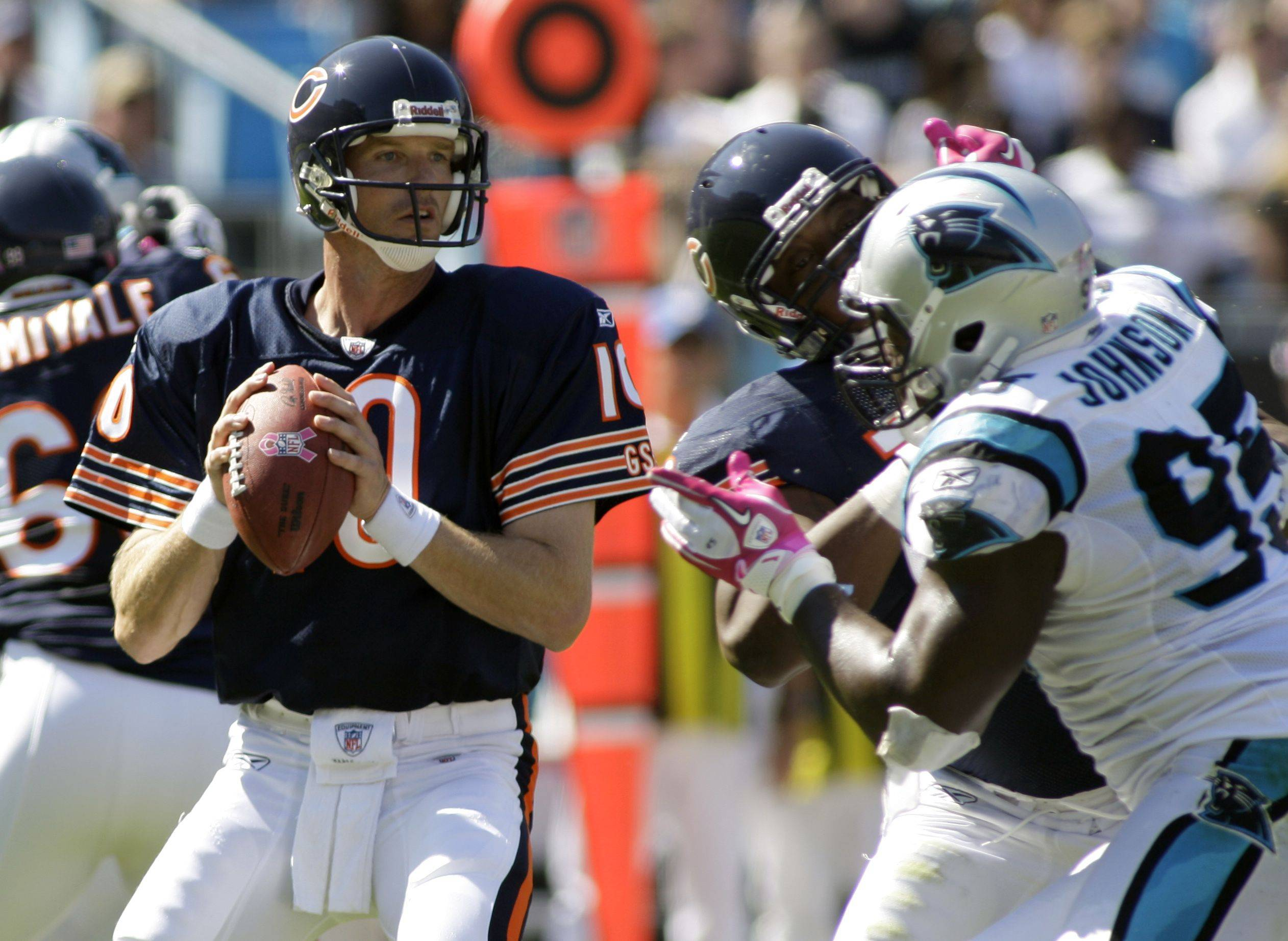 Chicago Bears quarterback Todd Collins (10) looks to pass under pressure from Carolina Panthers' Charles Johnson (95) in the first half of the Bears' 23-6 win in an NFL football game in Charlotte, N.C., Sunday.