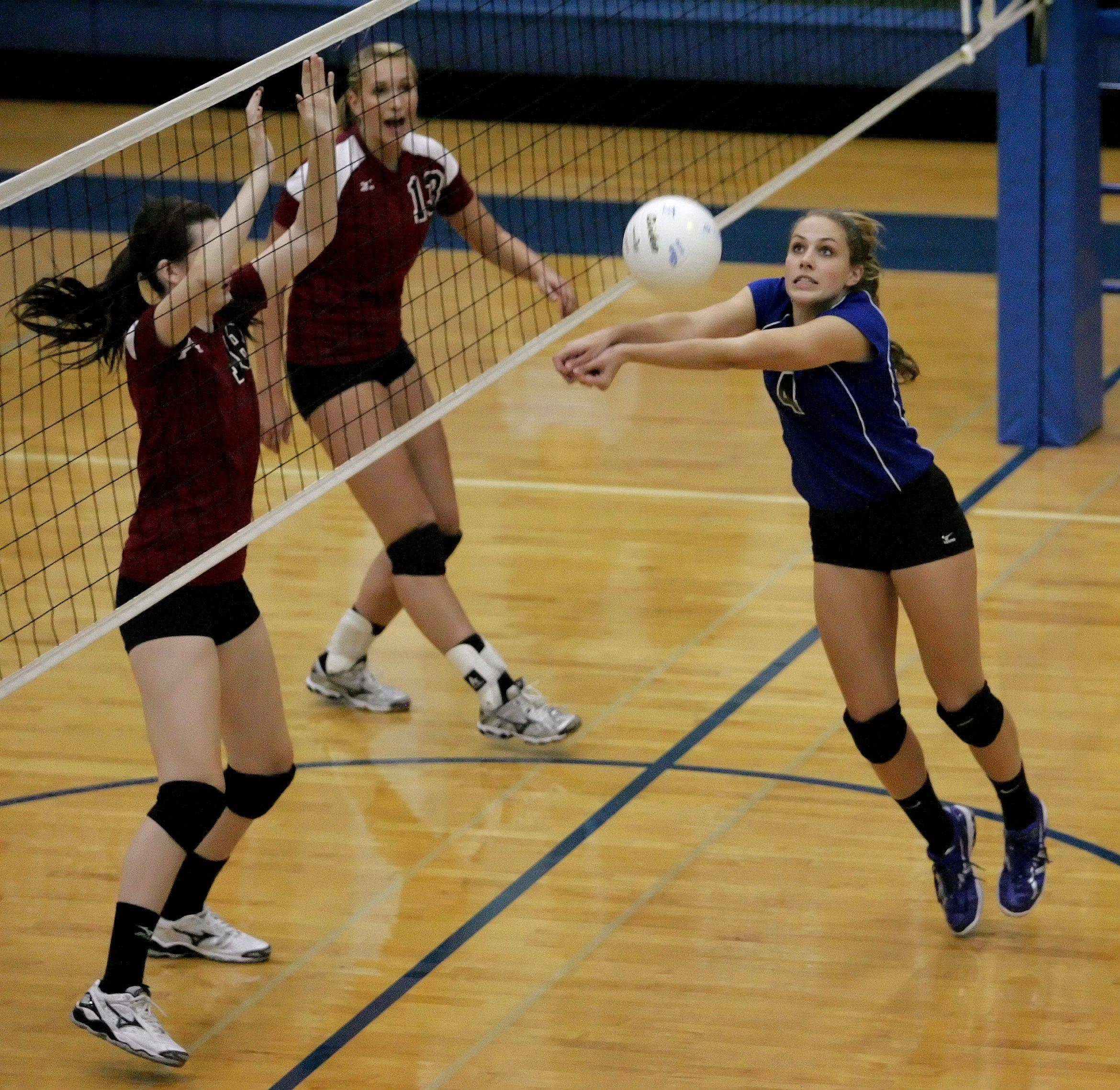 Kelly Reinke of St. Francis, right, gets to the ball during Monday's game against Wheaton Acadamy.