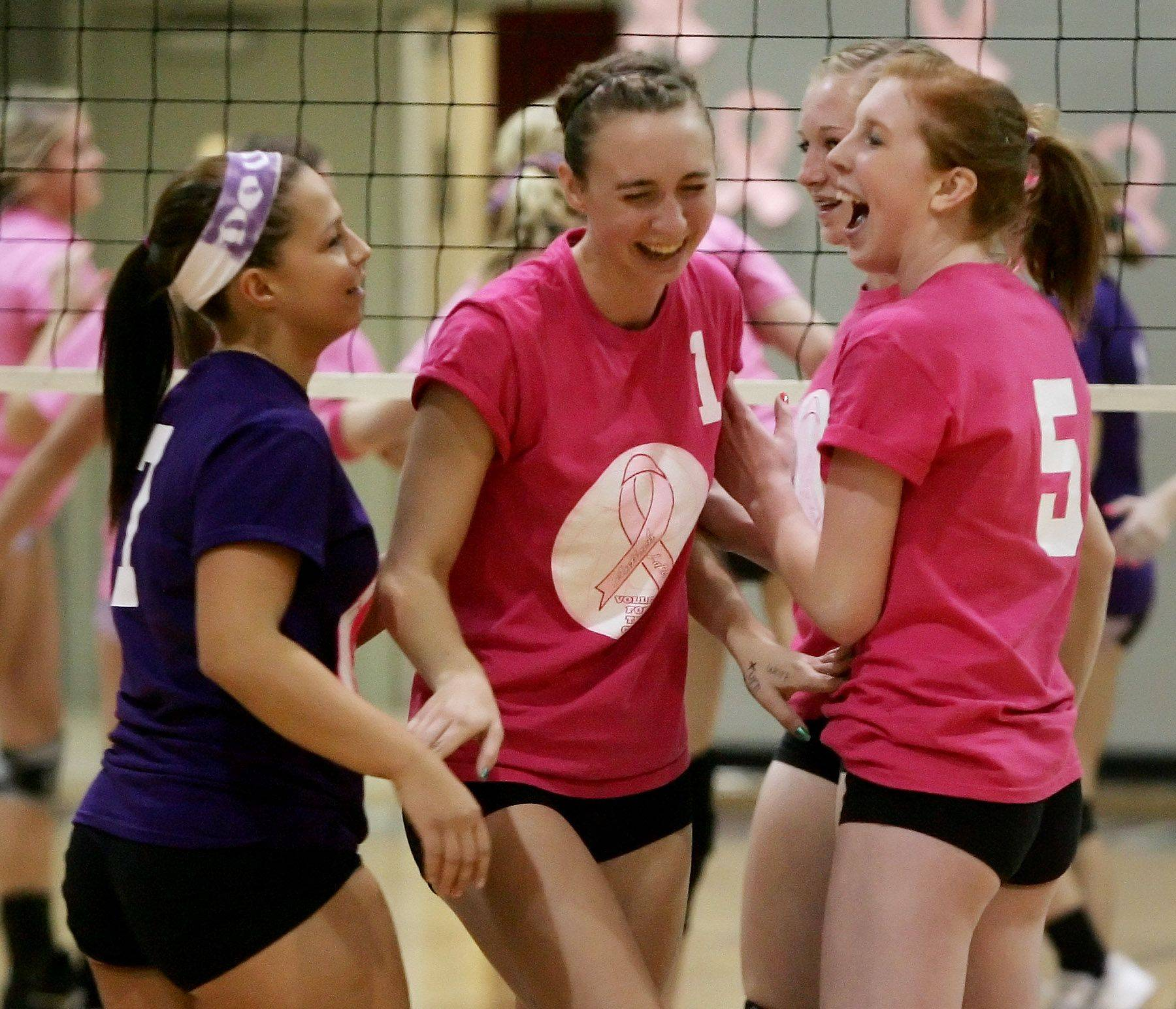 Lakes player Mary Doupis, Rachel Sieracke and Kailey Molloy celebrate a point during the girls volleyball game against Antioch Thursday.