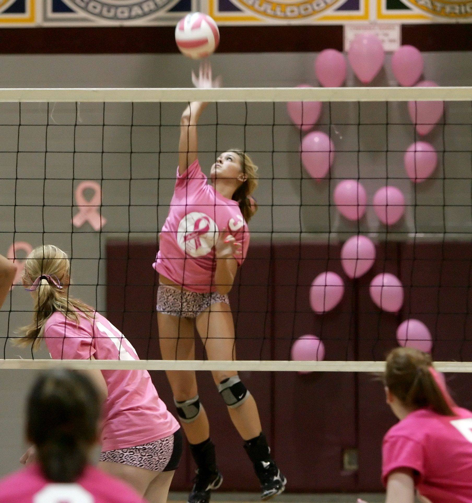 Antioch's Brianna Grant hits the ball during Thursday's game against Lakes. The game was the 4th Annual Volley for the Cure game for Breast Cancer Awareness.