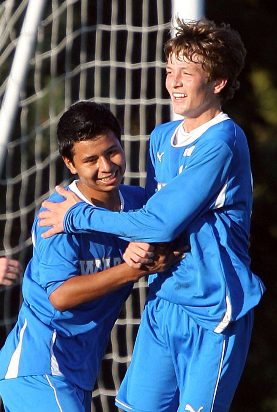 Warren's Auner Solis, left, celebrates with Billy Eddy after Eddy scored in the first half of Monday's game at the Libertyville Sports Complex.