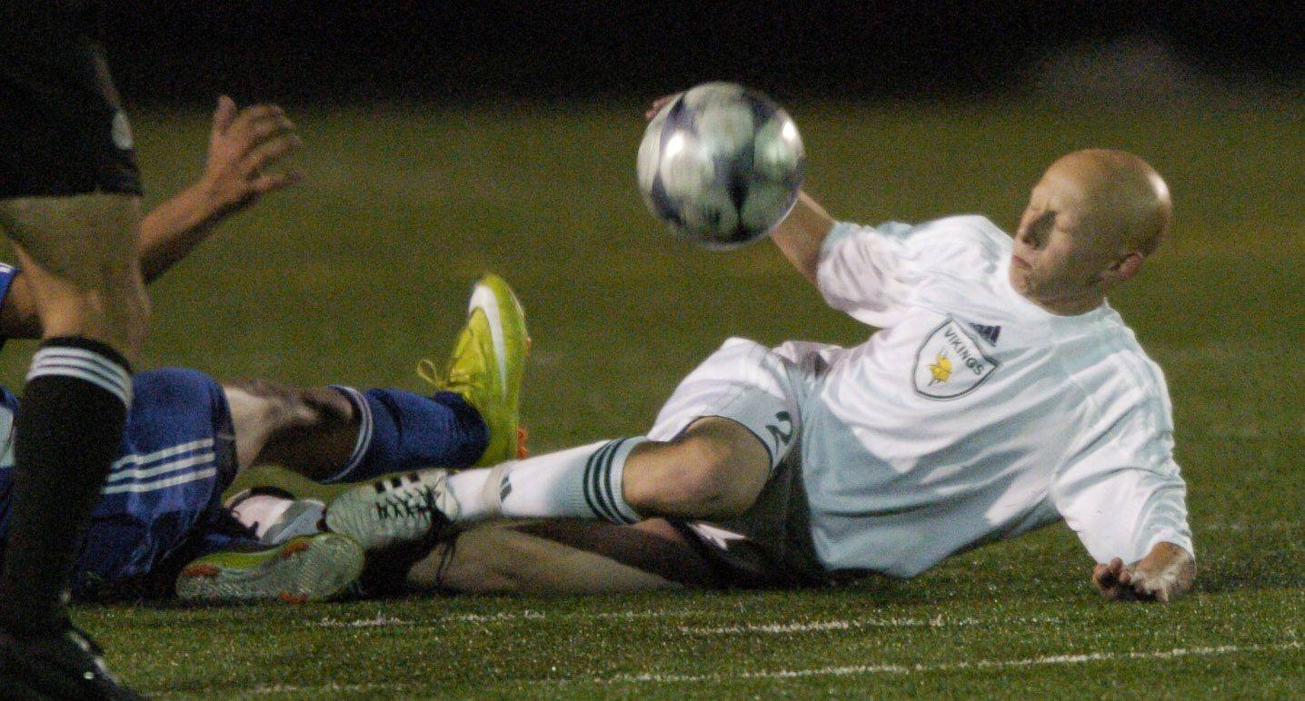 Fremd's Jeremy Koszac slides during an effort to control the balll at Tuesday's game against Hoffman Estates.