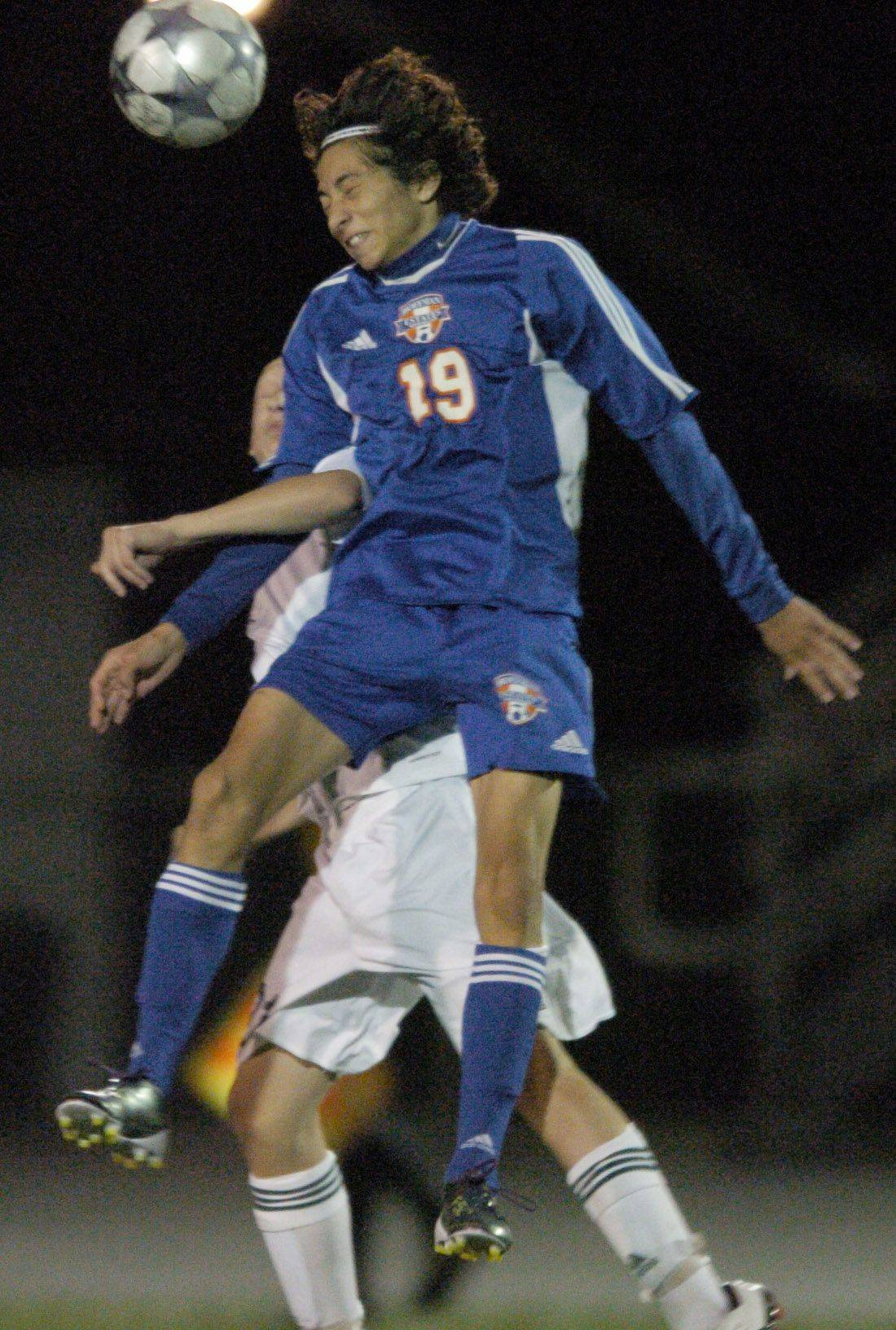 Hoffman Estates' Kevin Castro goes for the header with Fremd's Jeremy Koszac Tuesday.