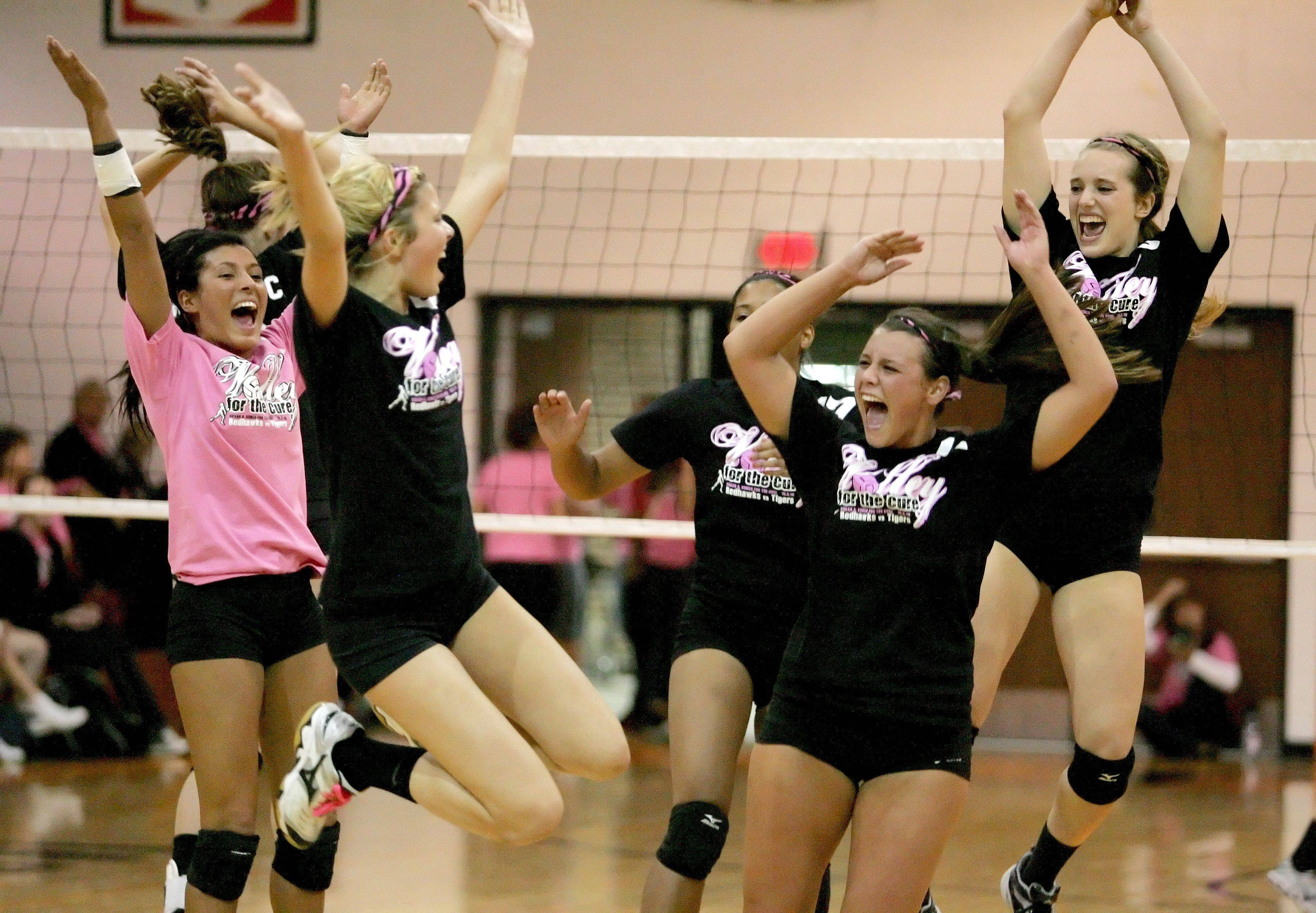 Wheaton Warrenville South celebrates a point against Naperville Central during girls volleyball action Tuesday in Wheaton.