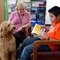 Lombard students practice reading to therapy dog