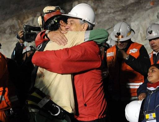 Chile's President Sebastian Pinera, front right, hugs rescued miner Florencio Avalos after Avalos was rescued from the the collapsed San Jose gold and copper mine where he was trapped with 32 other miners for over two months near Copiapo, Chile, Tuesday.
