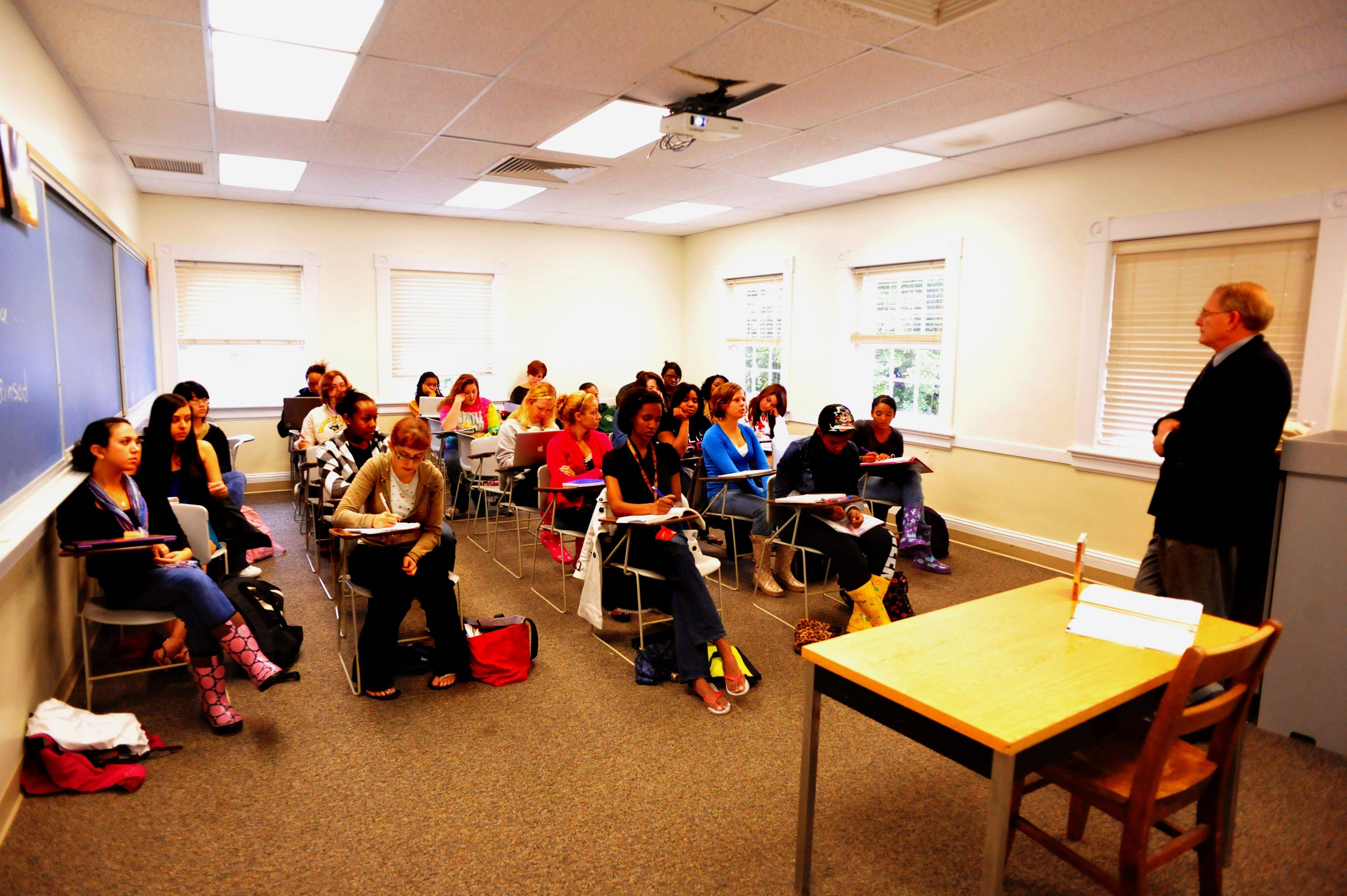Jenna Markovska, 15, left row, middle seat, sits in a comparative politics class taught by professor Gordon L. Bowen at Mary Baldwin College in Staunton, Va. The Palatine resident enrolled at the women's college at 14 years old.