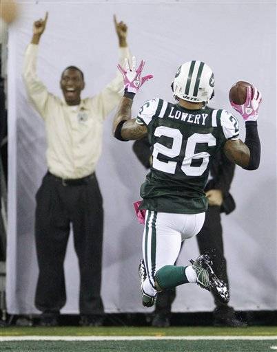 New York Jets' Dwight Lowery scores a touchdown after intercepting a pass late in the fourth quarter of an NFL football game against the Minnesota Vikings early Tuesday in East Rutherford, N.J.