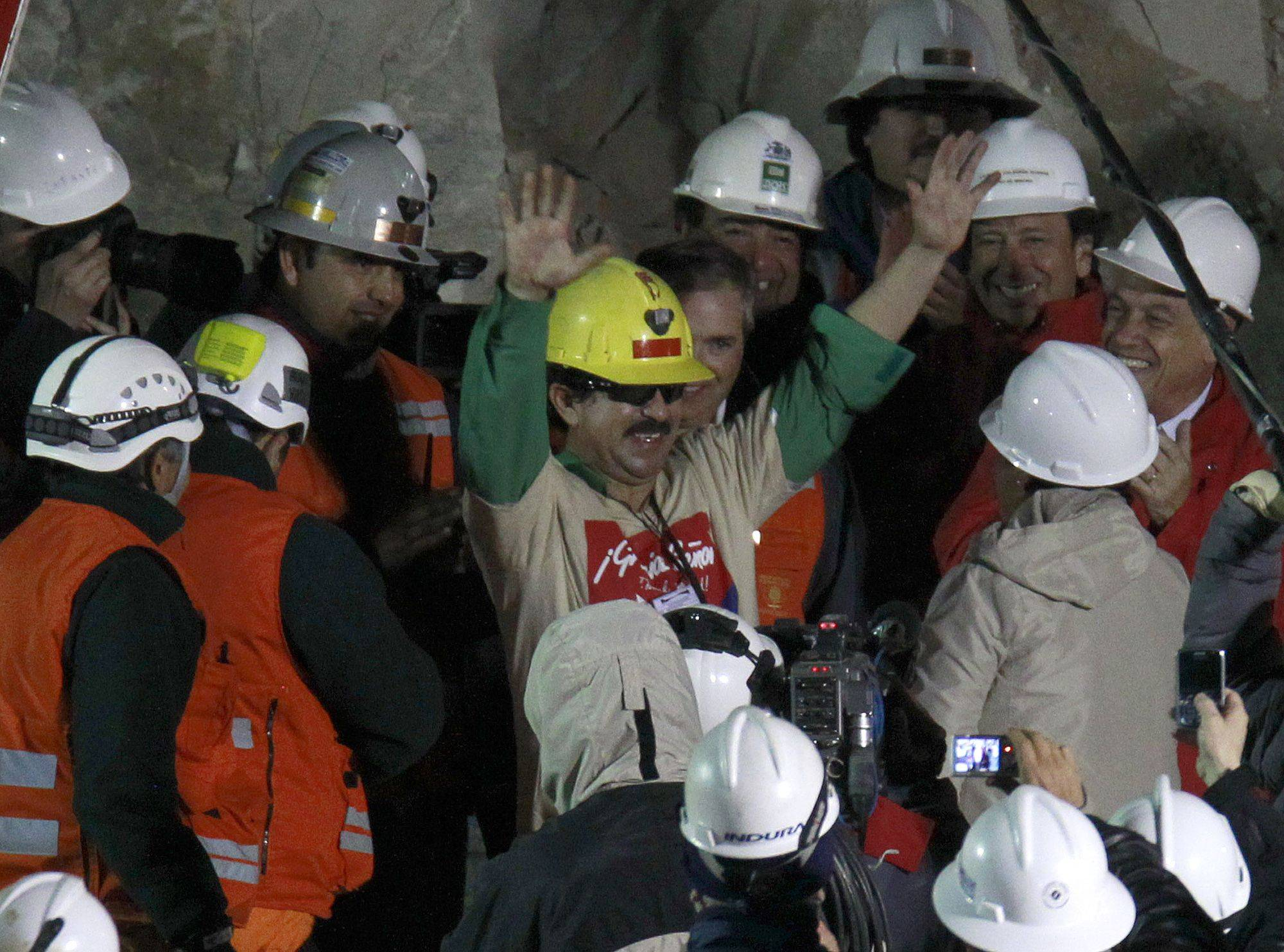 Rescued miner Juan Andres Illanes Palma, third miner to be rescued, salutes at his arrival to the surface from the collapsed San Jose gold and copper mine where he was trapped with 32 other miners for over two months near Copiapo, Chile, Wednesday Oct. 13, 2010.at the San Jose Mine near Copiapo, Chile Wednesday, Oct. 13, 2010.