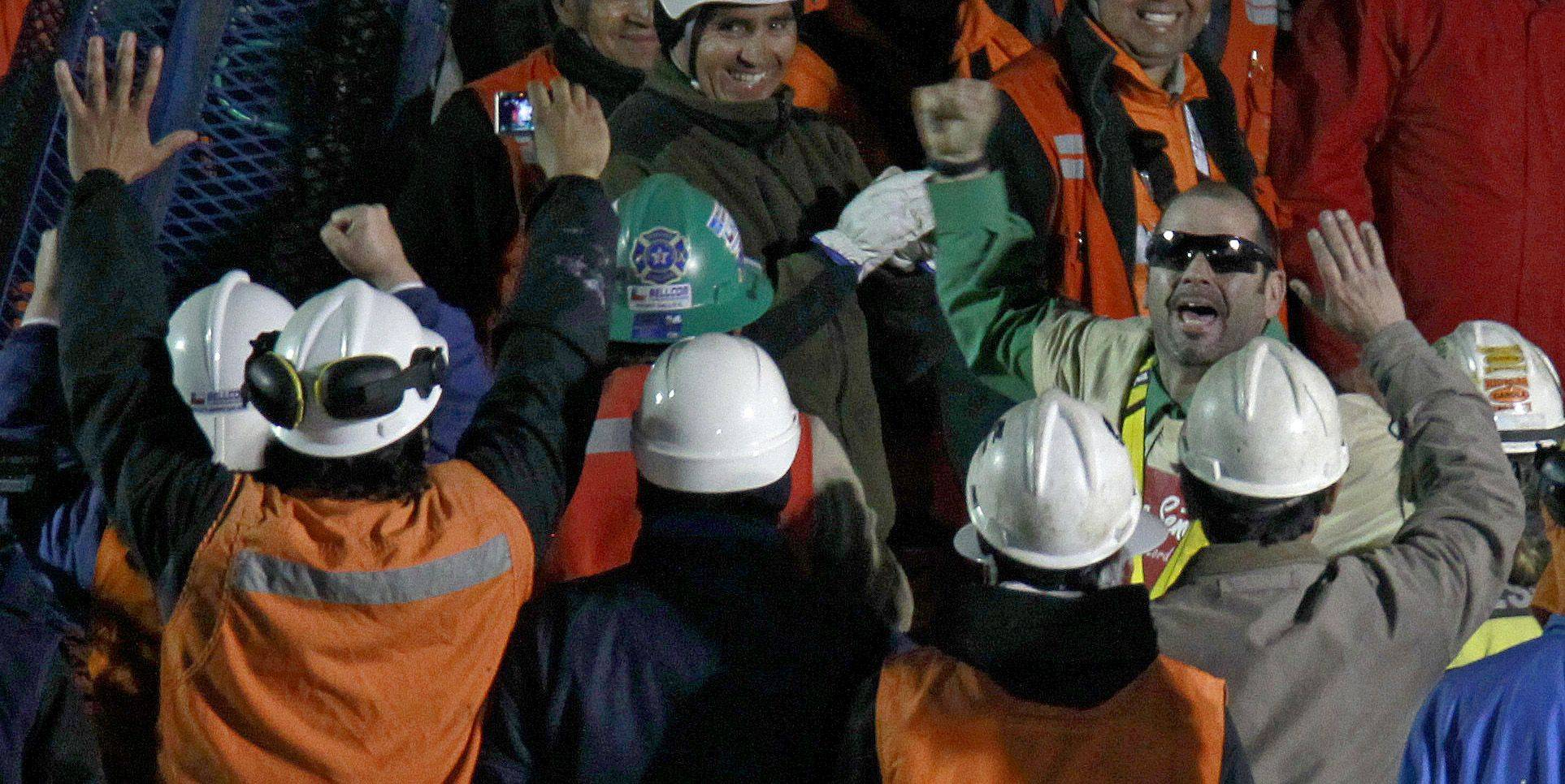Rescued miner Mario Sepulveda Espina, right, salutes after being rescued from the the collapsed San Jose gold and copper mine where he was trapped with 32 other miners for over two months near Copiapo, Chile, early Wednesday Oct. 13, 2010.
