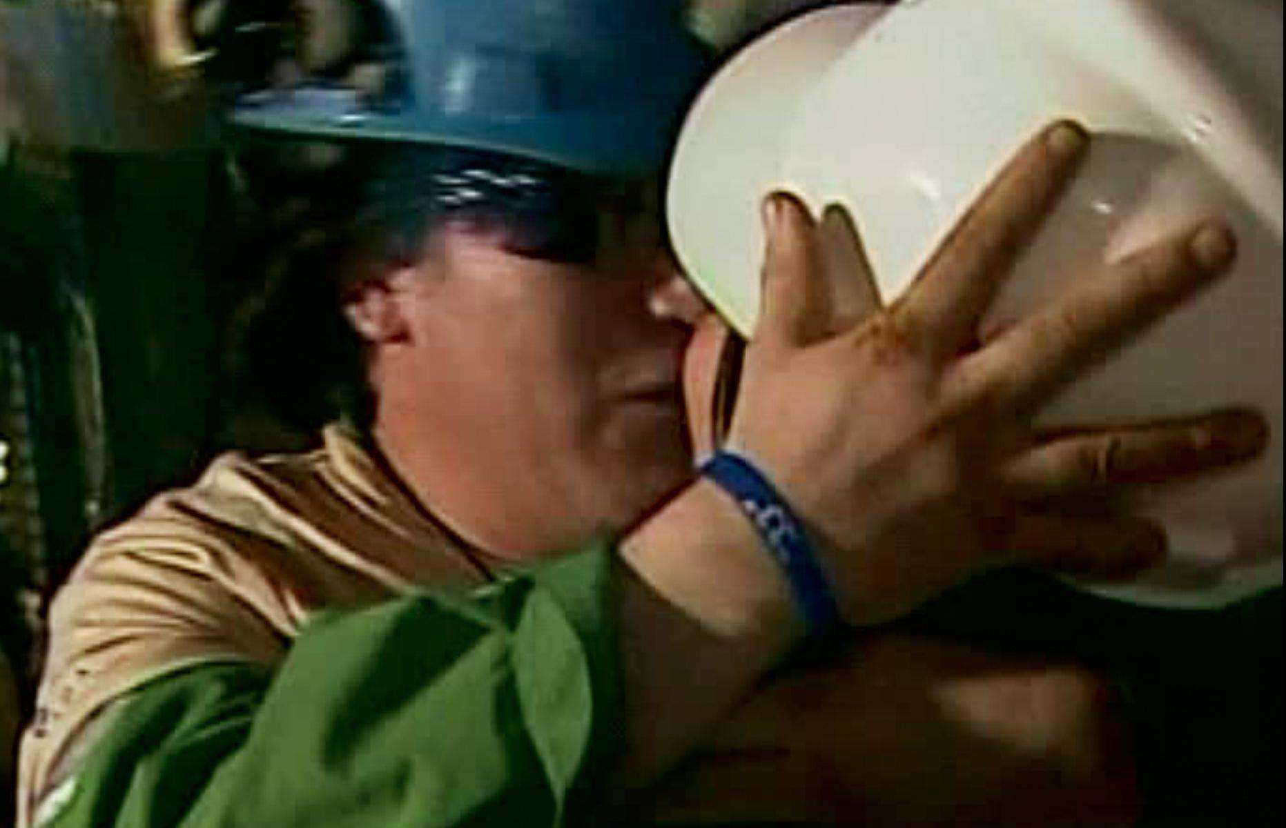 In this screen grab taken from video, Osman Araya, the sixth miner to be rescued, greets a relative after his rescue Wednesday, Oct. 13, 2010 at San Jose Mine near Copiapo, Chile.