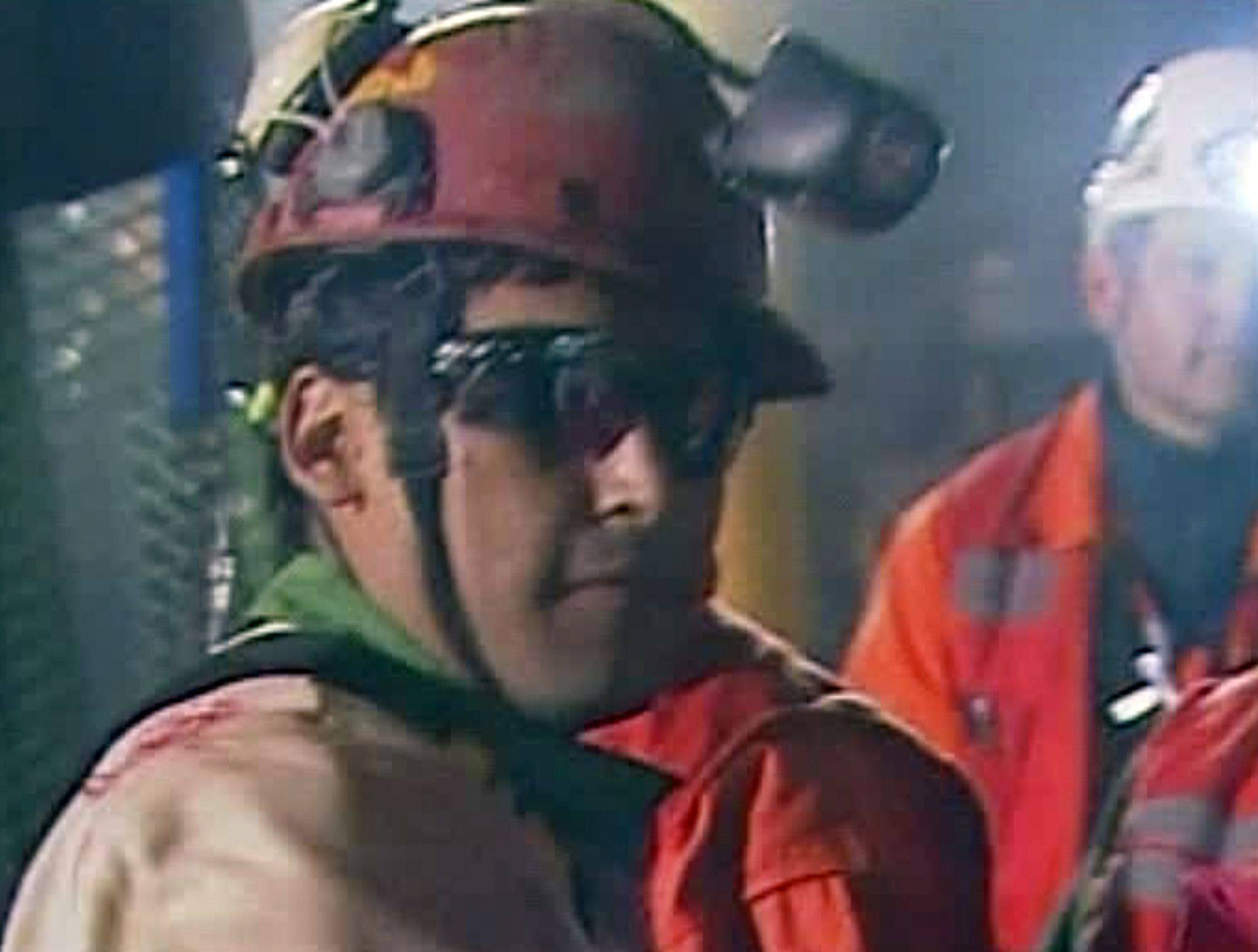 In this screen grab taken from video, Florencio Avalos, the first miner to be rescued, center, is greeted after his rescue Tuesday, Oct. 12, 2010 at San Jose Mine near Copiapo, Chile.