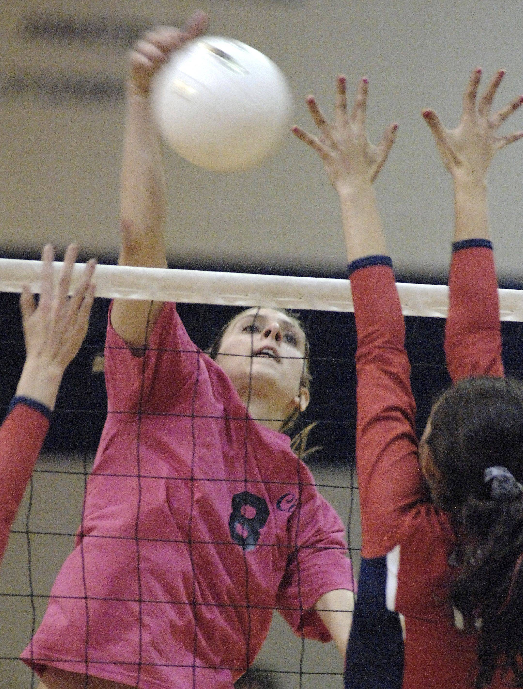 West Chicago's Emily Paschke tips the ball past West Aurora in a game on Oct. 12. Just as its girls' volleyball team was closing in on its first DuPage Valley Conference title in 30 years, Community High School is considering leaving the conference to compete as an independent.