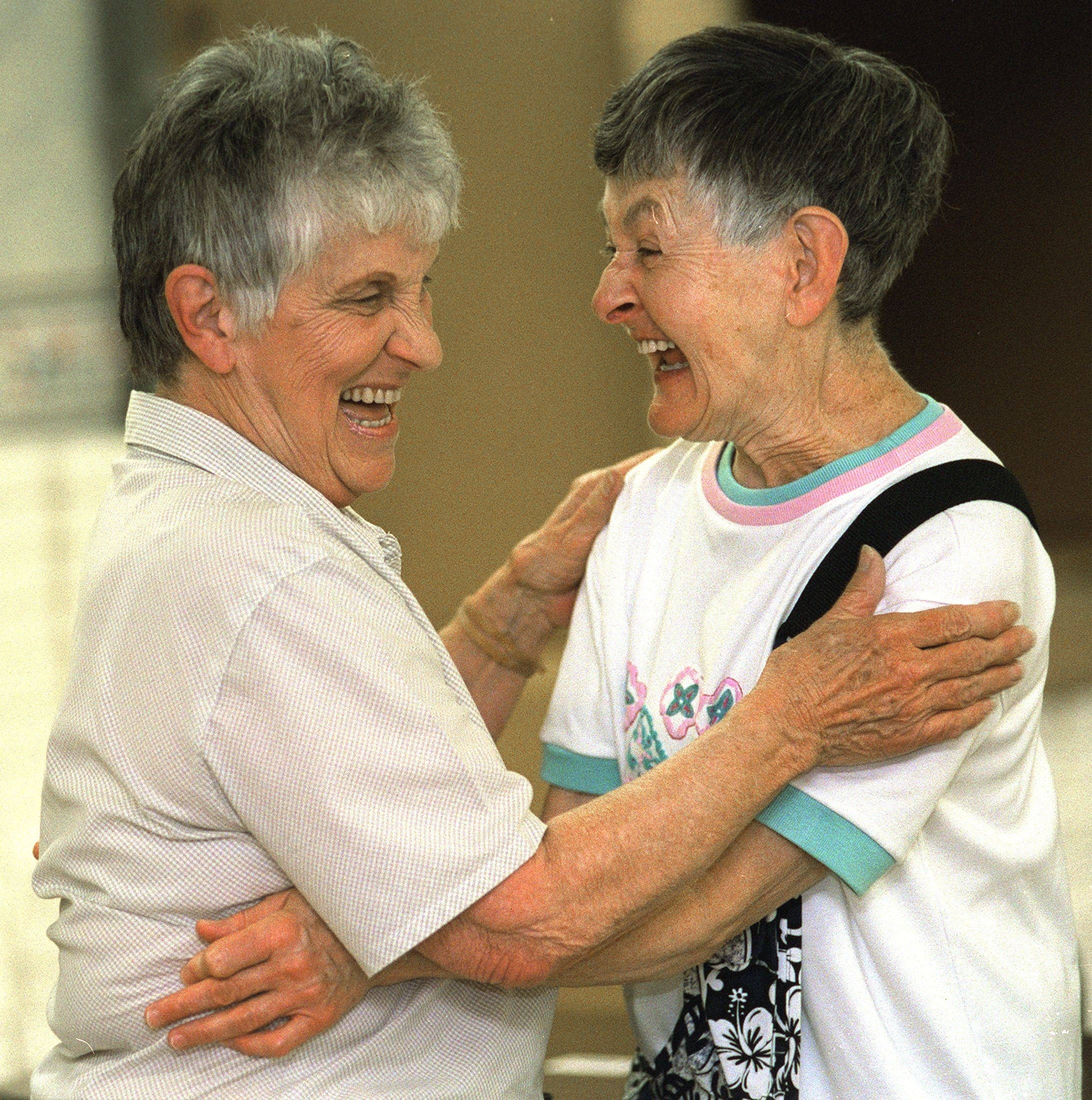 "In this file photo, Donna Crook, also known as ""Grandma, and Margie Dennehy hug and greet each other at the start of a work day at the Valley Sheltered Workshop in Batavia. Crook's illness and death was very sad for workers and supervisors at the workshop."