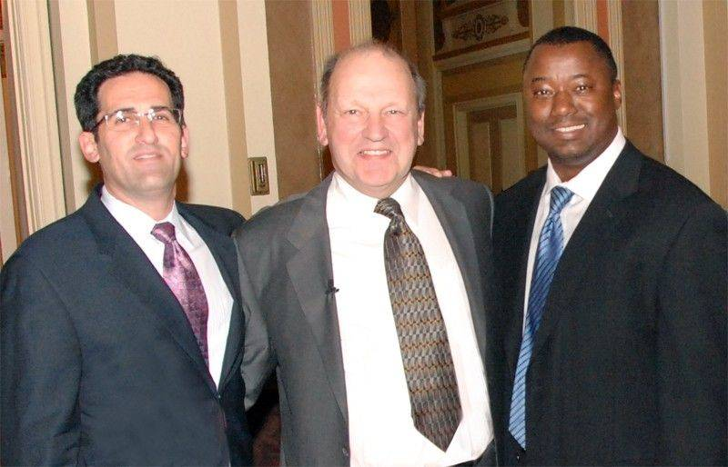 A hero pilot already credited with helping to save 184 people in a fiery 1989 plane crash, Denny Fitch of St. Charles brings that same determination and spirit to his fight against brain cancer. Fitch _ flanked by Drs. Jeffrey Raizer, left, and James Chandler, right, co-directors of the Northwestern Brain Tumor Institute _ delivered the keynote address during a recent fundraiser.