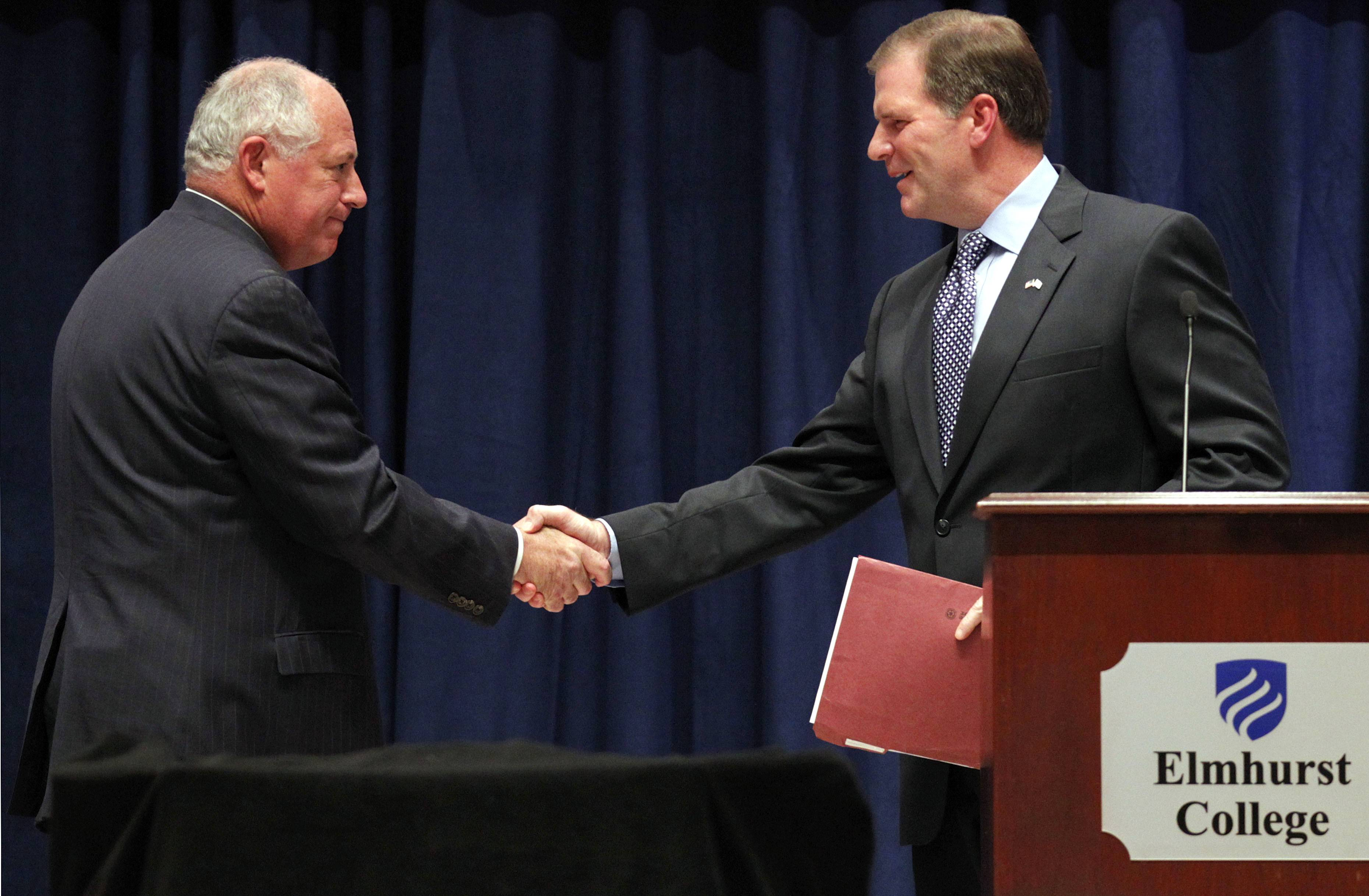 Gov. Pat Quinn and state Sen. Bill Brady shake hands after a debate at Elmhurst College on Sunday.