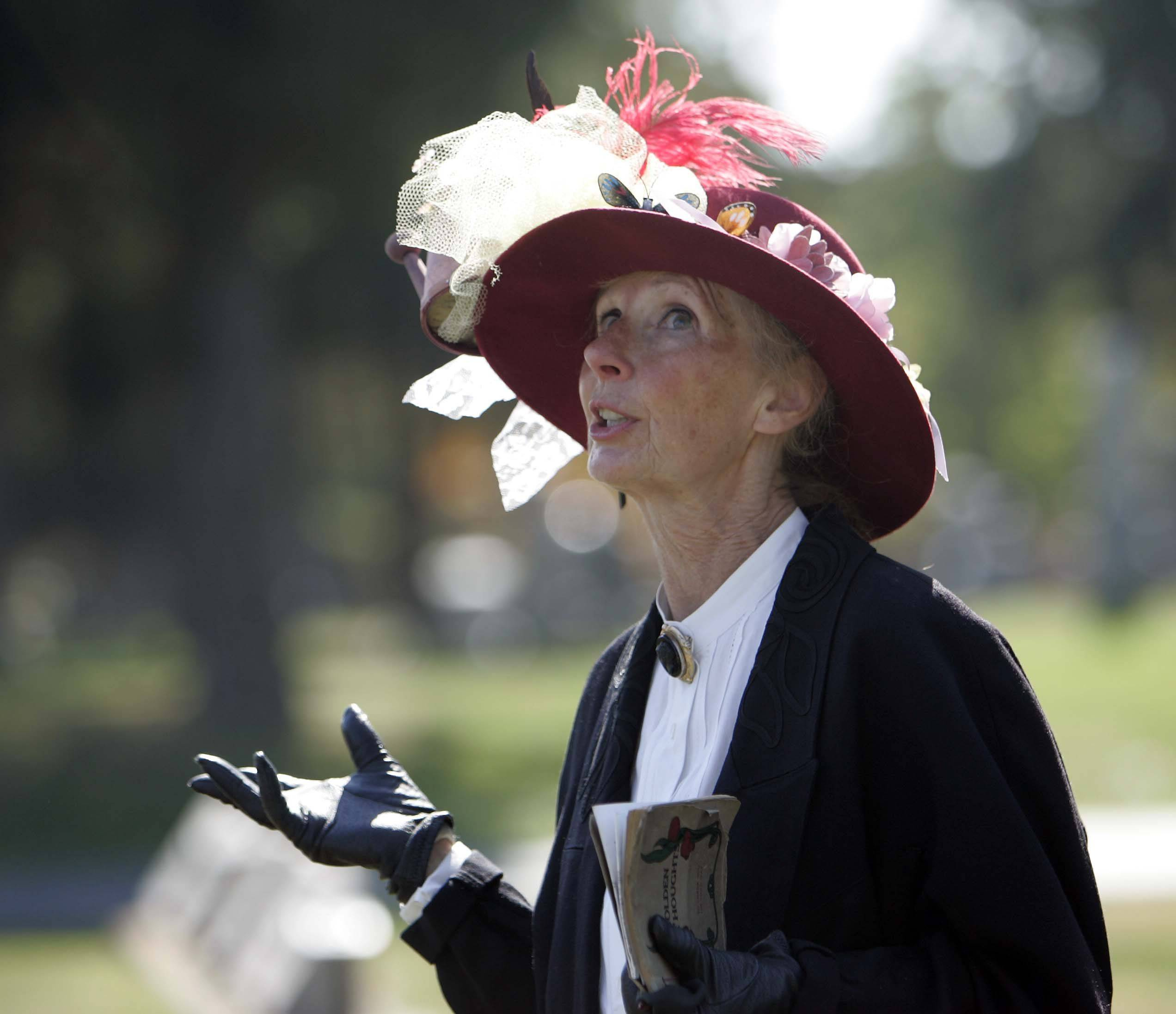 Connie Gush portrays owner and publisher of the Valley Chronicle Lina Paschel during the St. Charles Heritage Center Grave Reminders: A Pathway to the Past Cemetery walk at the North Cemetery in St. Charles Saturday, October 9.