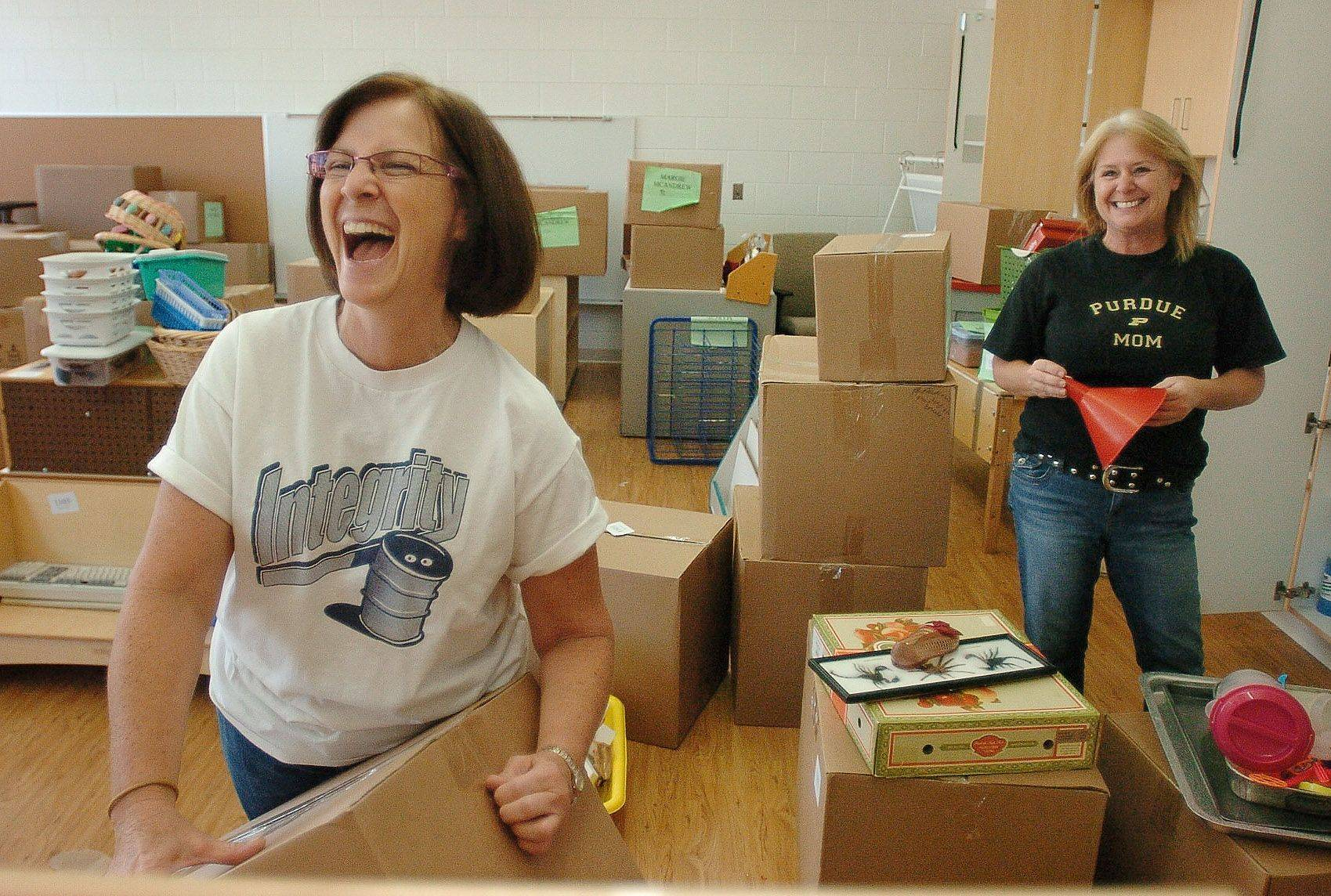 Teacher Margie McAndrew, left, and teacher's assistant Dawn Sasser are happy they're moving into their new digs at District 220's new Early Learning Center in Barrington.