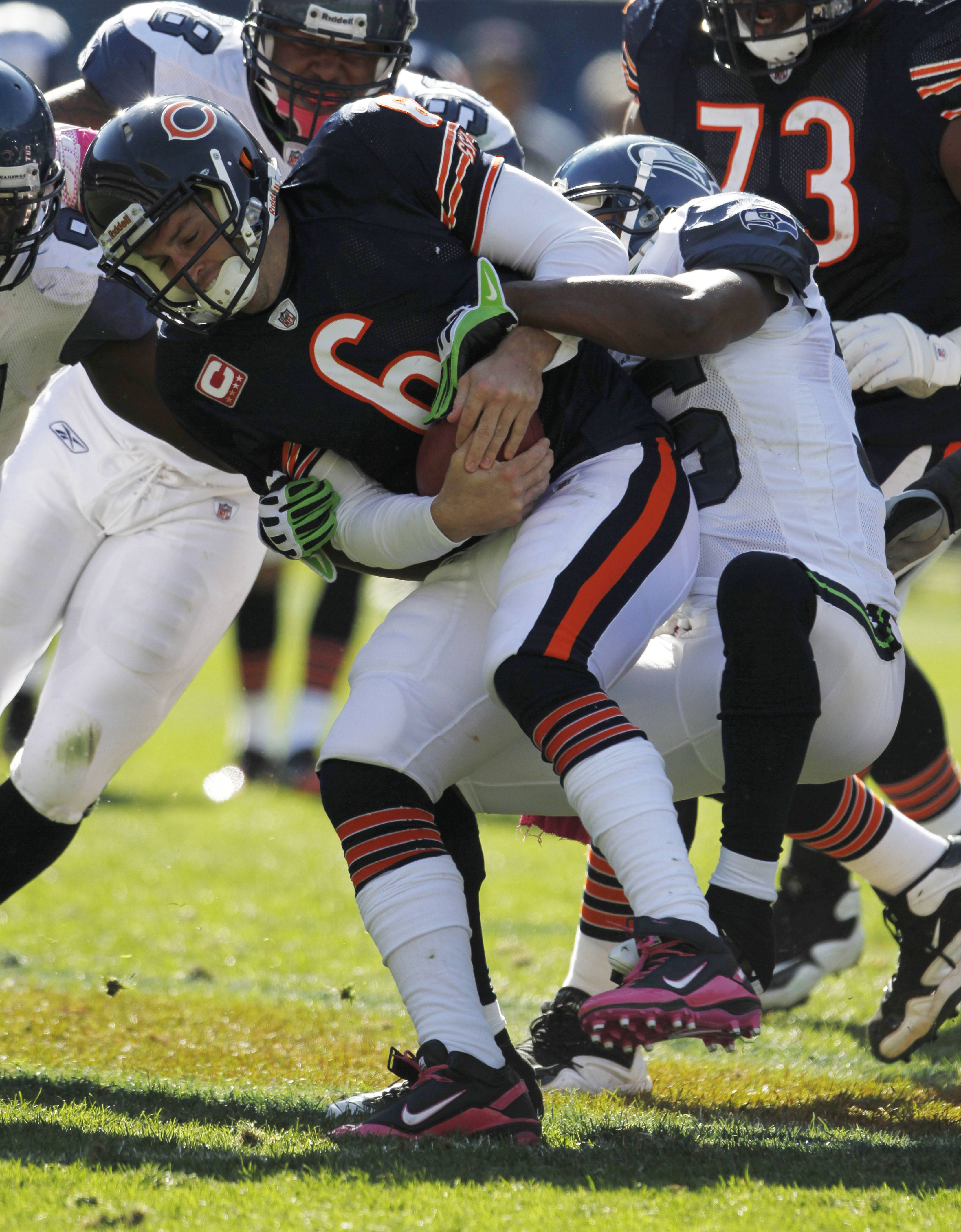 Bears quarterback Jay Cutler is sacked by Seattle Seahawks safety Lawyer Milloy in the second half.
