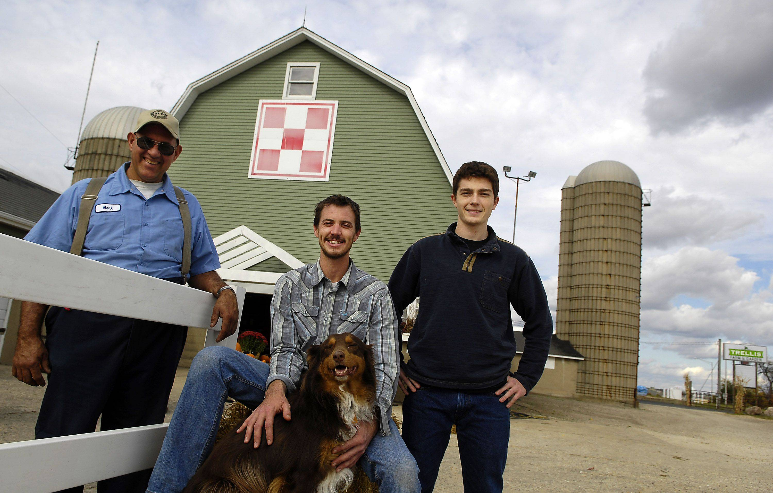 Tom Stopka, center, and his family have opened Trellis Farm and Garden in the former location of the Regole's Harvest Shoppe in St. Charles. He's joined in the photo by Trellis employees Colton Schuetz, right, and Mark Regole, whose family still owns the property.