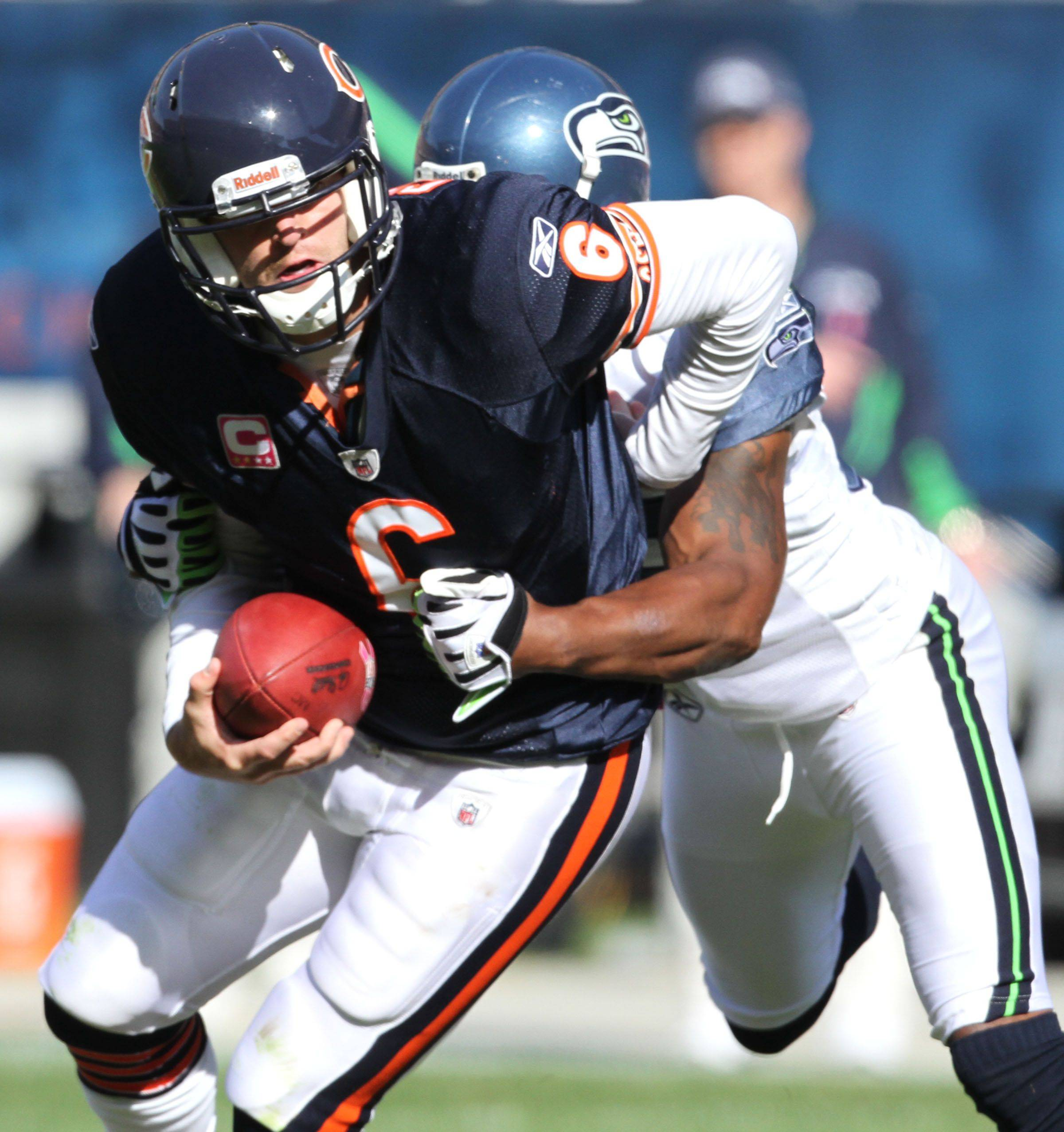 Chicago Bears' Chicago Bears quarterback Jay Cutler is sacked by Seattle Seahawks' safety Lawyer Milloy in the second half in 23-20 lose at Soldier Field in Chicago on Sunday, October 17.