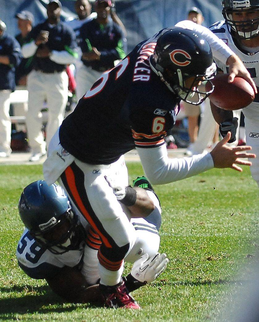 Chicago Bears quarterback Jay Cutler is sacked by Seattle Seahawks linebacker Aaron Curry.