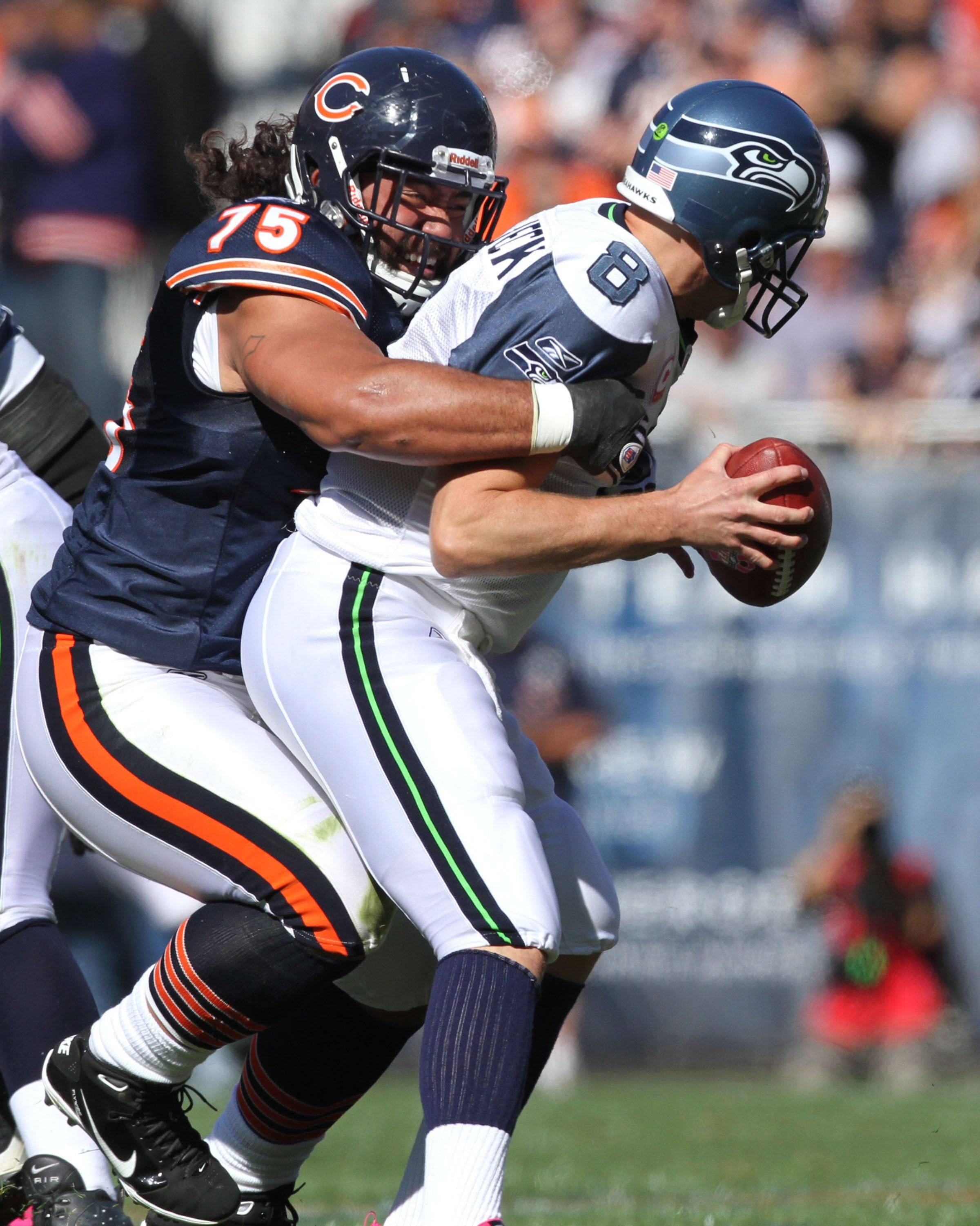 Bears' defensive tackle Matt Toeaina pulls down Seattle Seahawks' quarterback Matt Hasselbeck which was ruled an incomplete pass at Soldier Field.