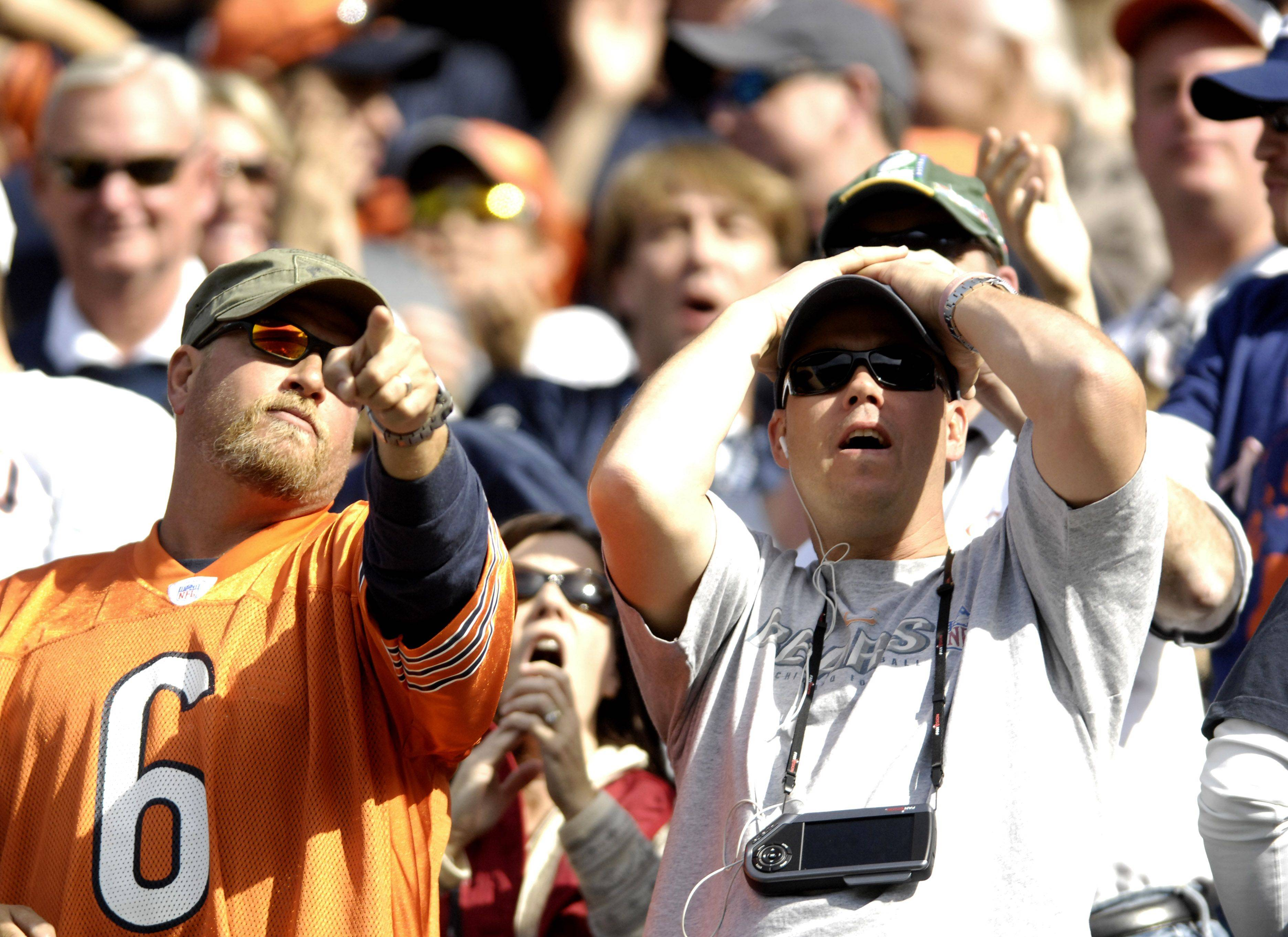 A pair of fans react to seeing a flag on the field after Danieal Manning's kickoff return for a touchdown.