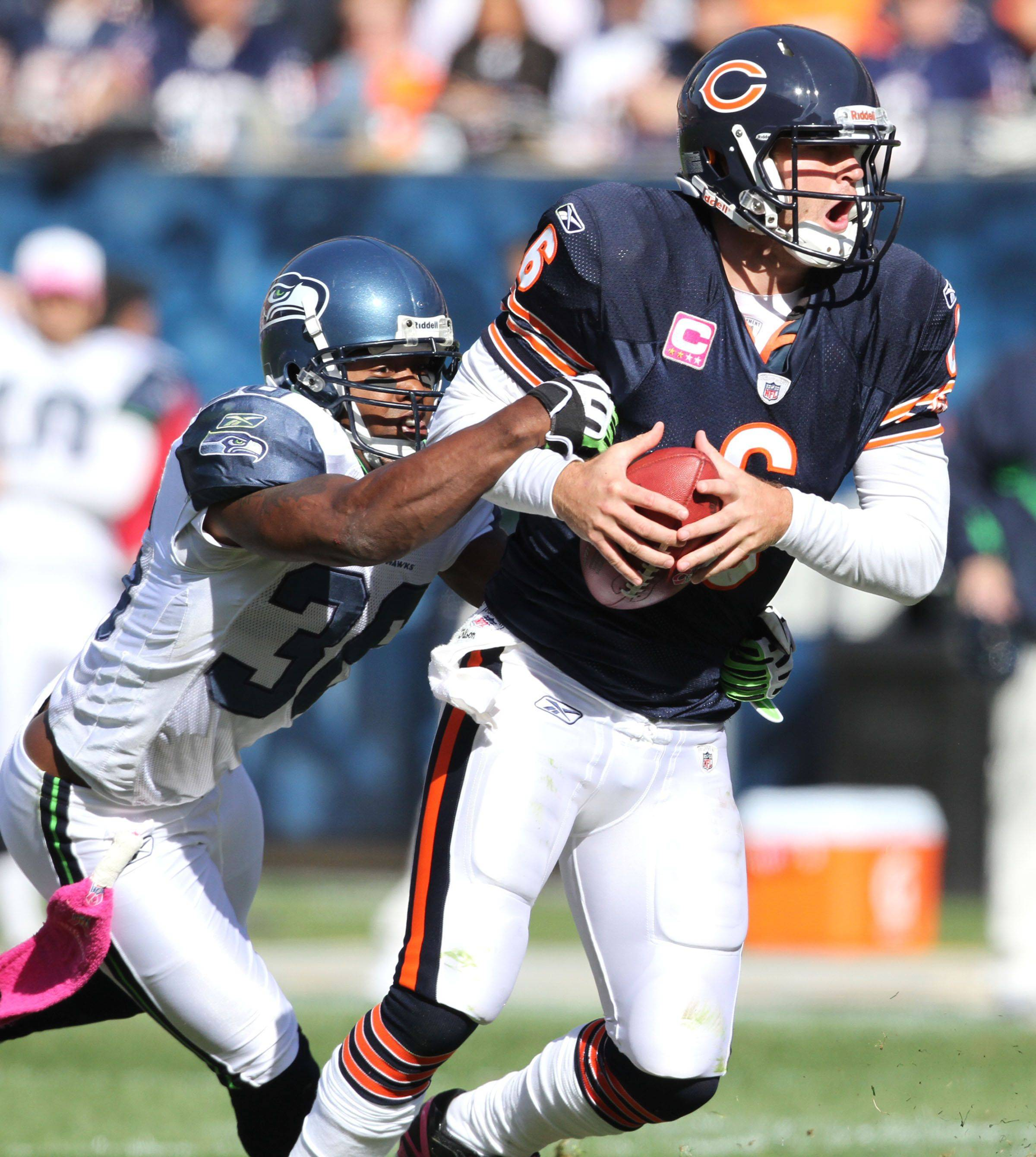 Chicago Bears' Chicago Bears quarterback Jay Cutler is sacked by Seattle Seahawks' safety Lawyer Milloy in the second half.