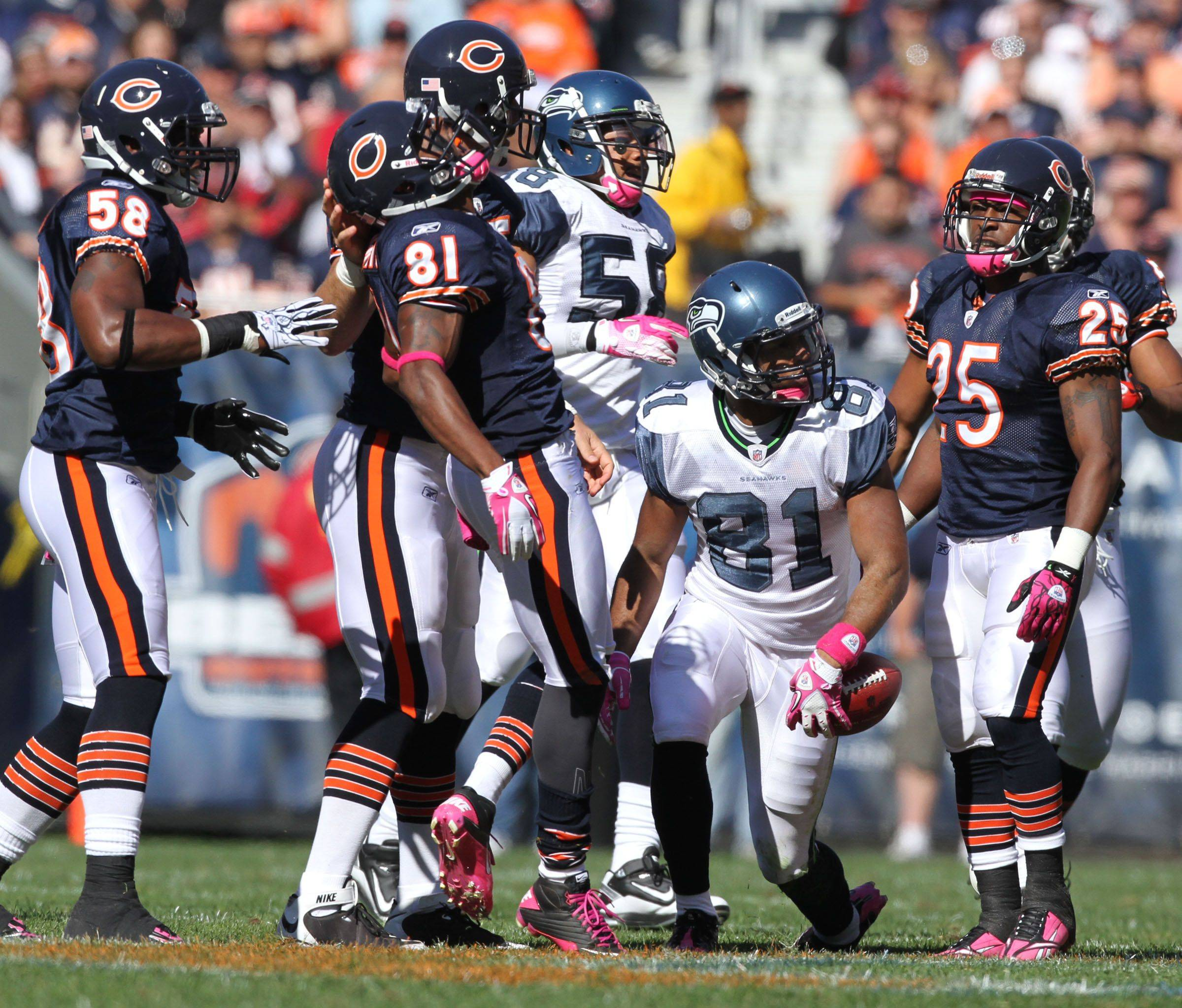 Chicago Bears celebrate pulling down Seattle Seahawks' wide receiver Golden Tate returning a punt at Soldier Field.