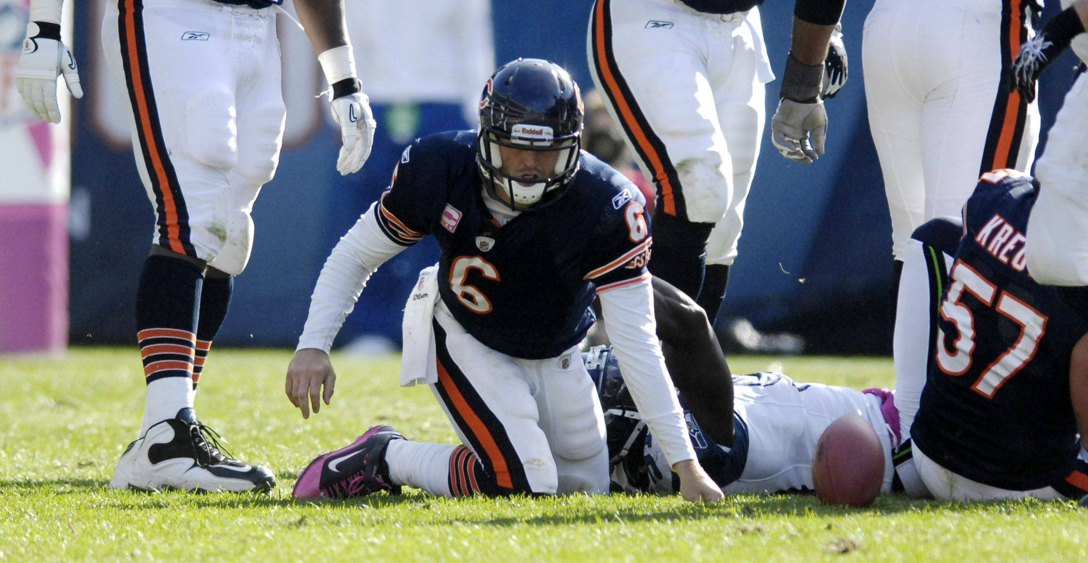 RICK WEST/rwest@dailyherald.comChicago Bears quarterback Jay Cutler gets up slowly after a sack.
