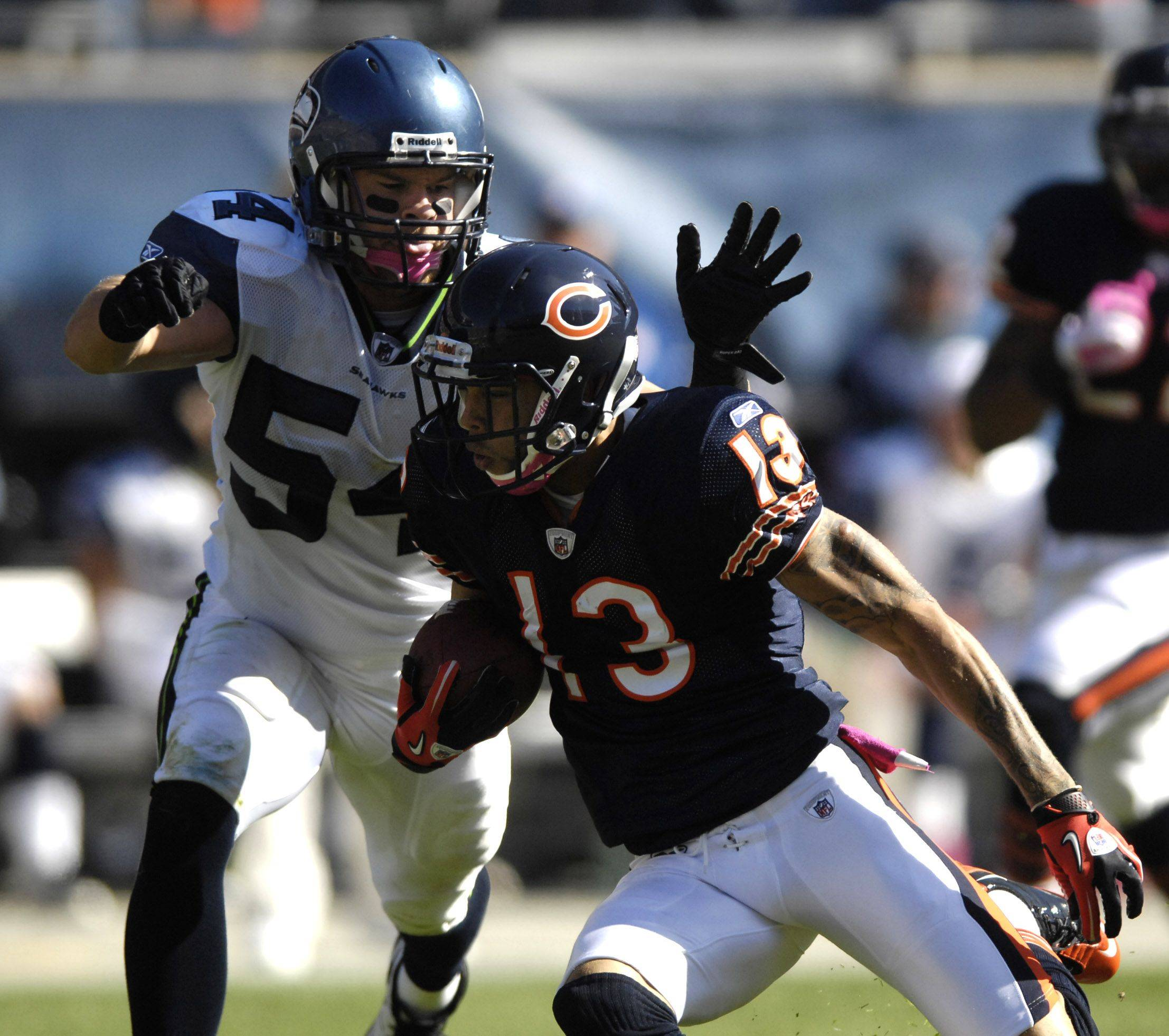 Chicago Bears wide receiver Johnny Knox is pursued by Seattle Seahawks linebacker Will Herring.